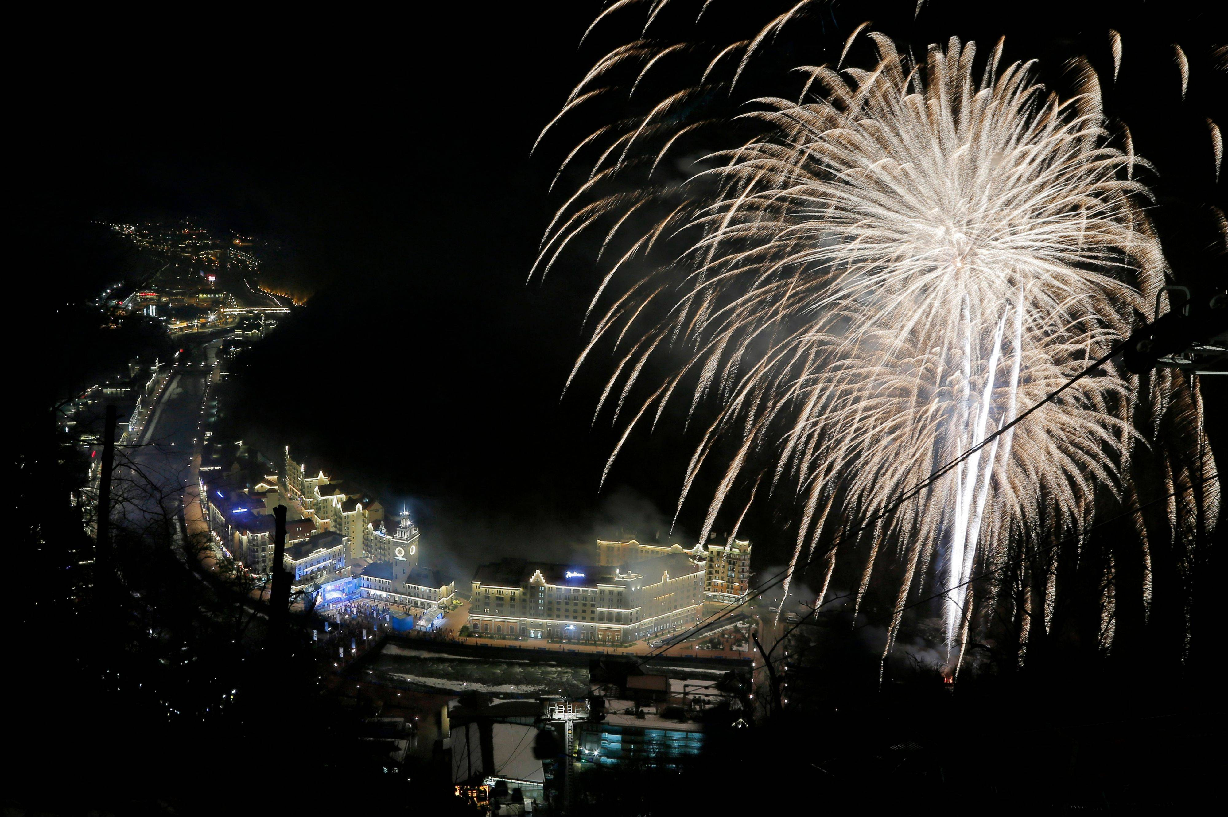 Fireworks explode over Roza Khutor, near Krasnaya Polyana, Russia, the mountain Olympic cluster, Friday, Feb. 7, 2014, during opening of the 2014 Winter Olympics.