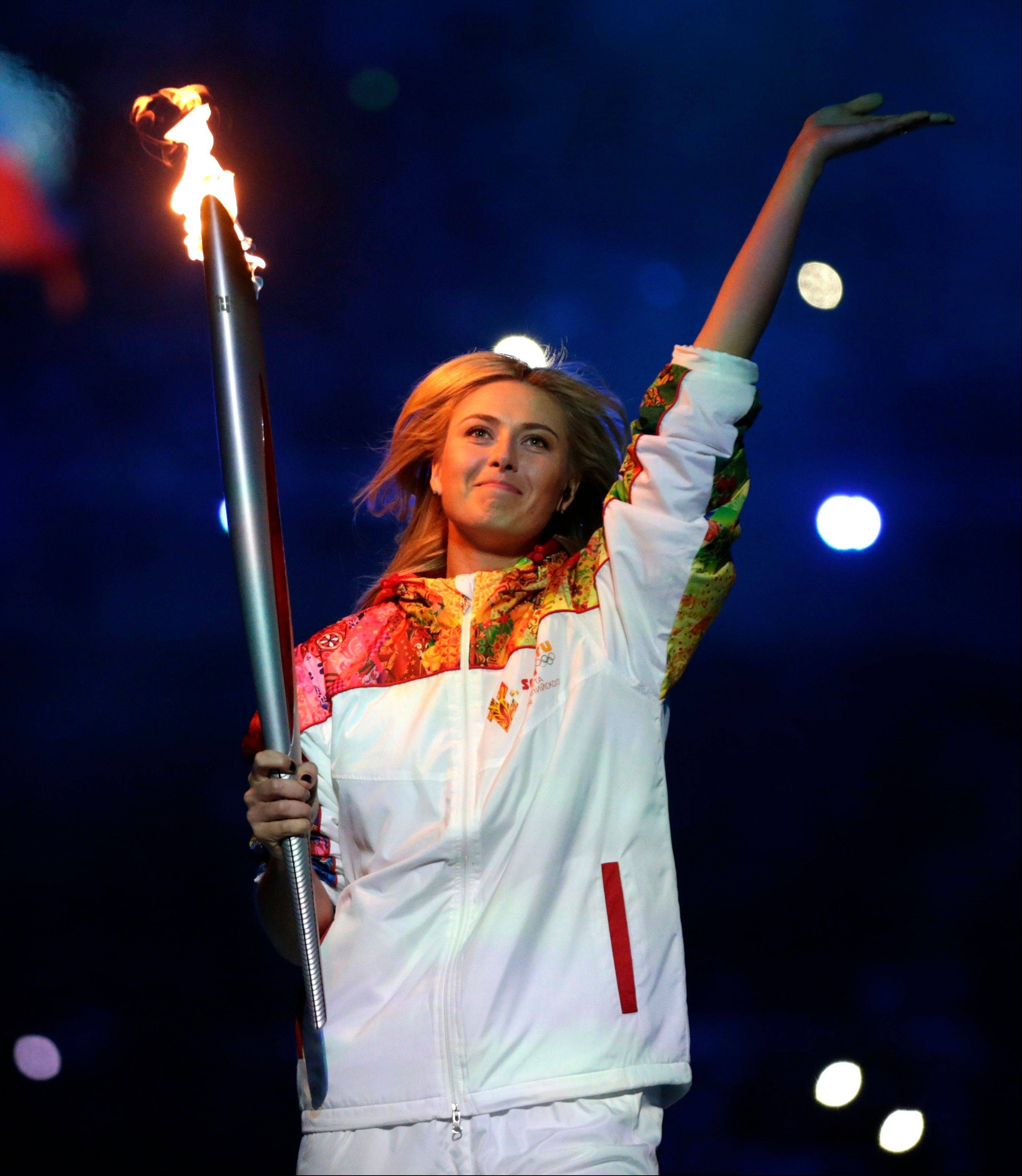 Russia's Maria Sharapova carries the torch during the opening ceremony.