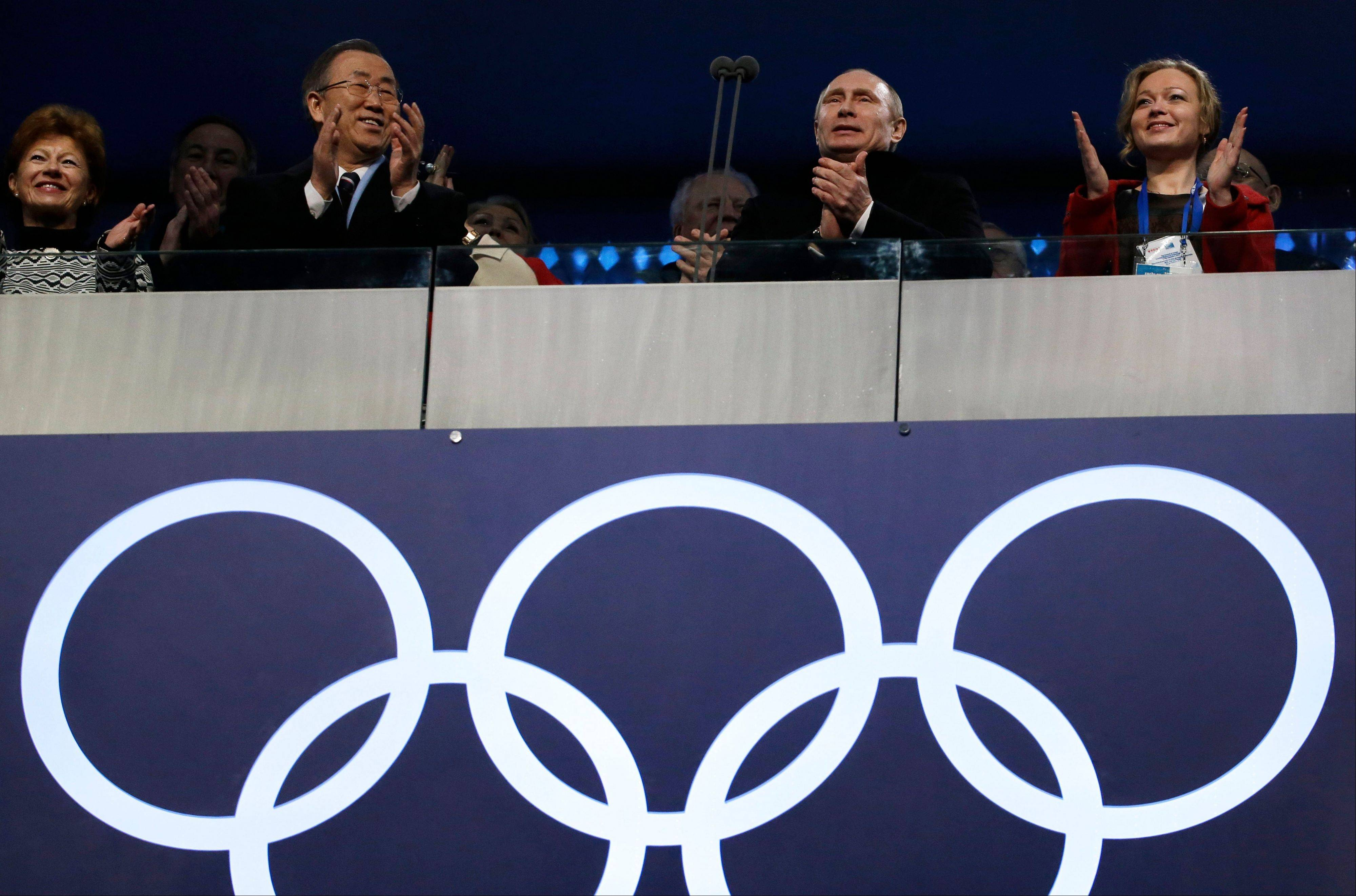 United Nations Secretary-General Ban Ki-moon, second from left, Russian President Vladimir Putin, centre, and Russian bobsledder Irina Skvortsova, right, applaud during the opening ceremony.
