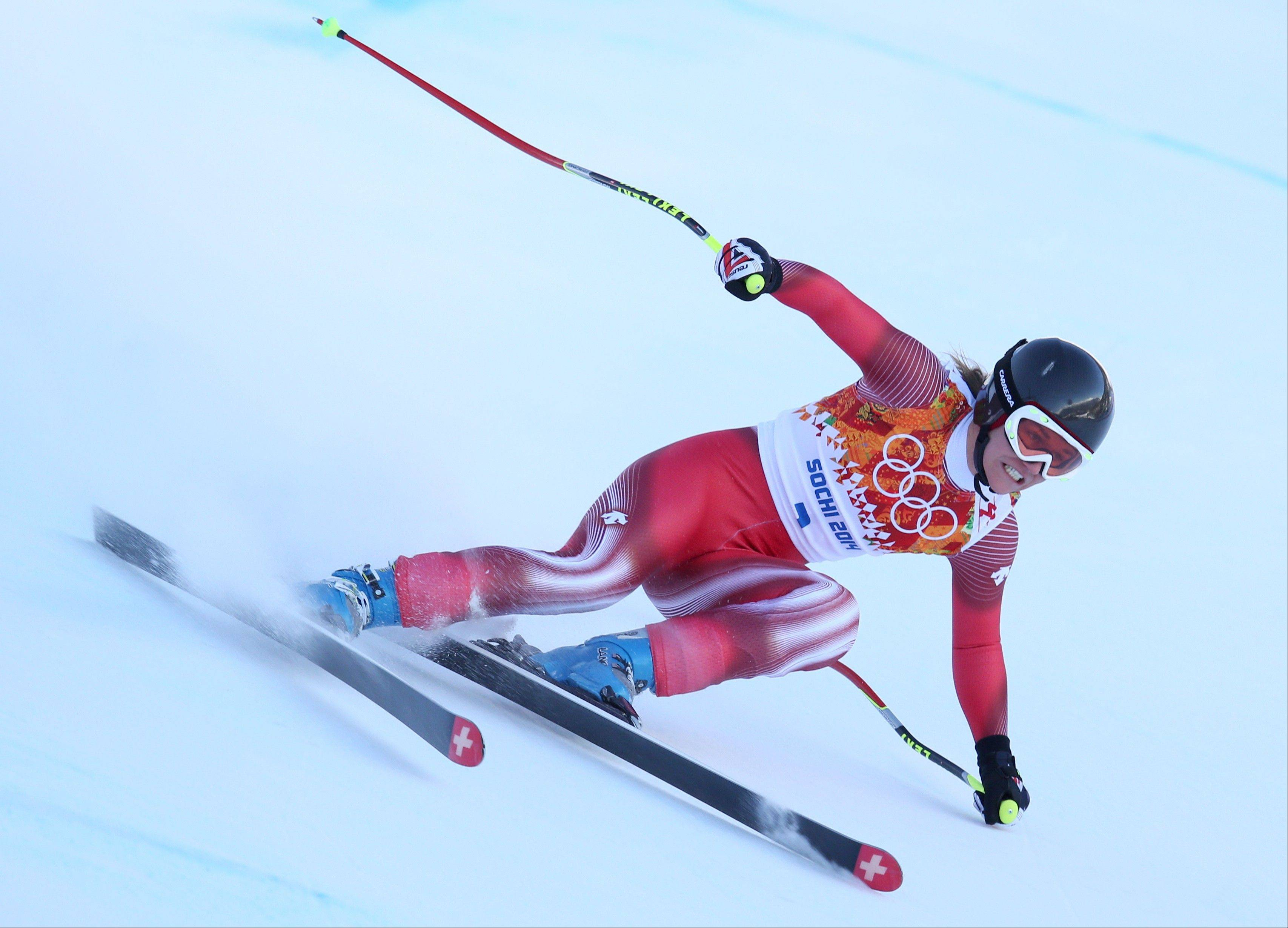 Switzerland's Fabienne Suter makes a turn Friday in a women's downhill training run for the Sochi 2014 Winter Olympics in Krasnaya Polyana, Russia.
