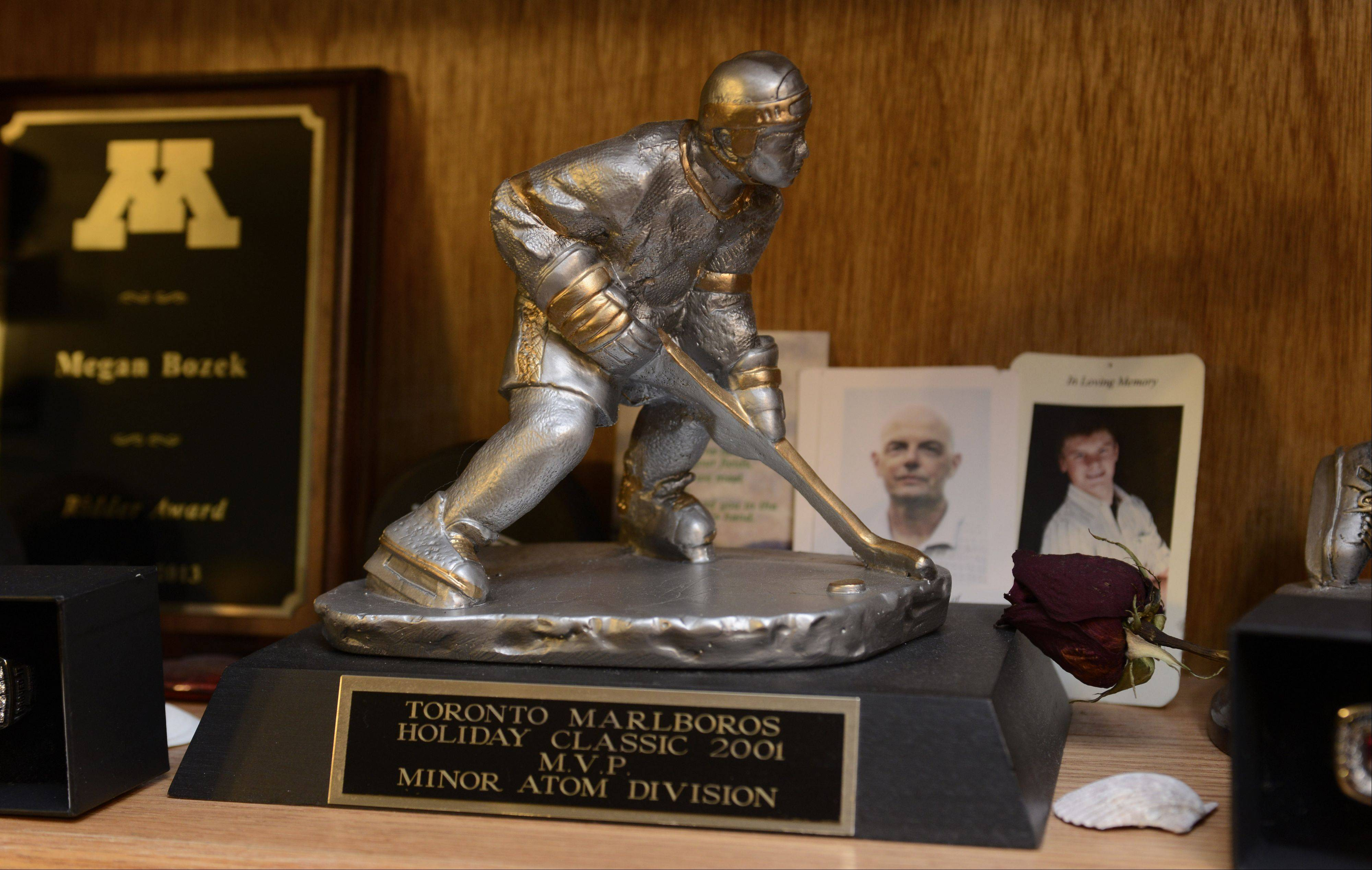 While Megan Bozek has won eight state titles in youth hockey, two NCAA championships in college and two World Championships, her parents say they are most proud of this MVP trophy she earned while playing in a Toronto tournament on an otherwise all-boys team at age 9.