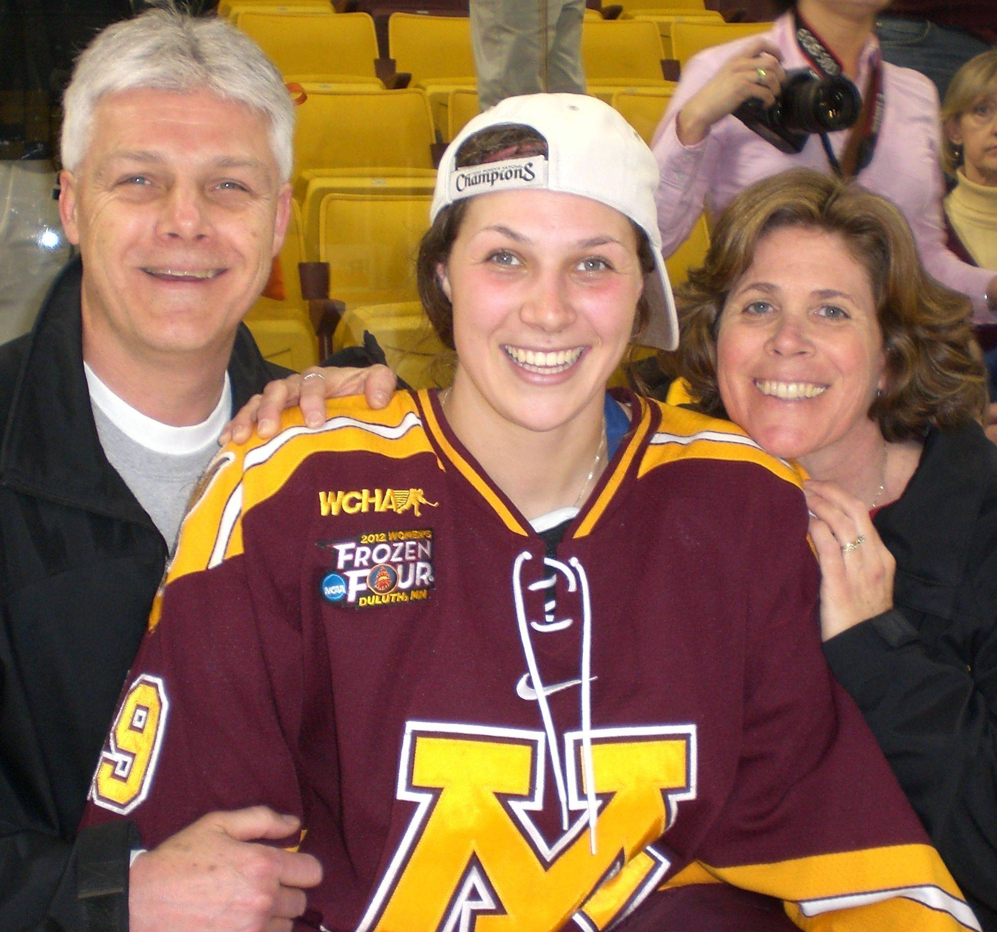 Megan Bozek was a co-captain on the undefeated University of Minnesota women's hockey team that won the 2012 NCAA title. She posed with her parents, Tom and Patti, after the title game.
