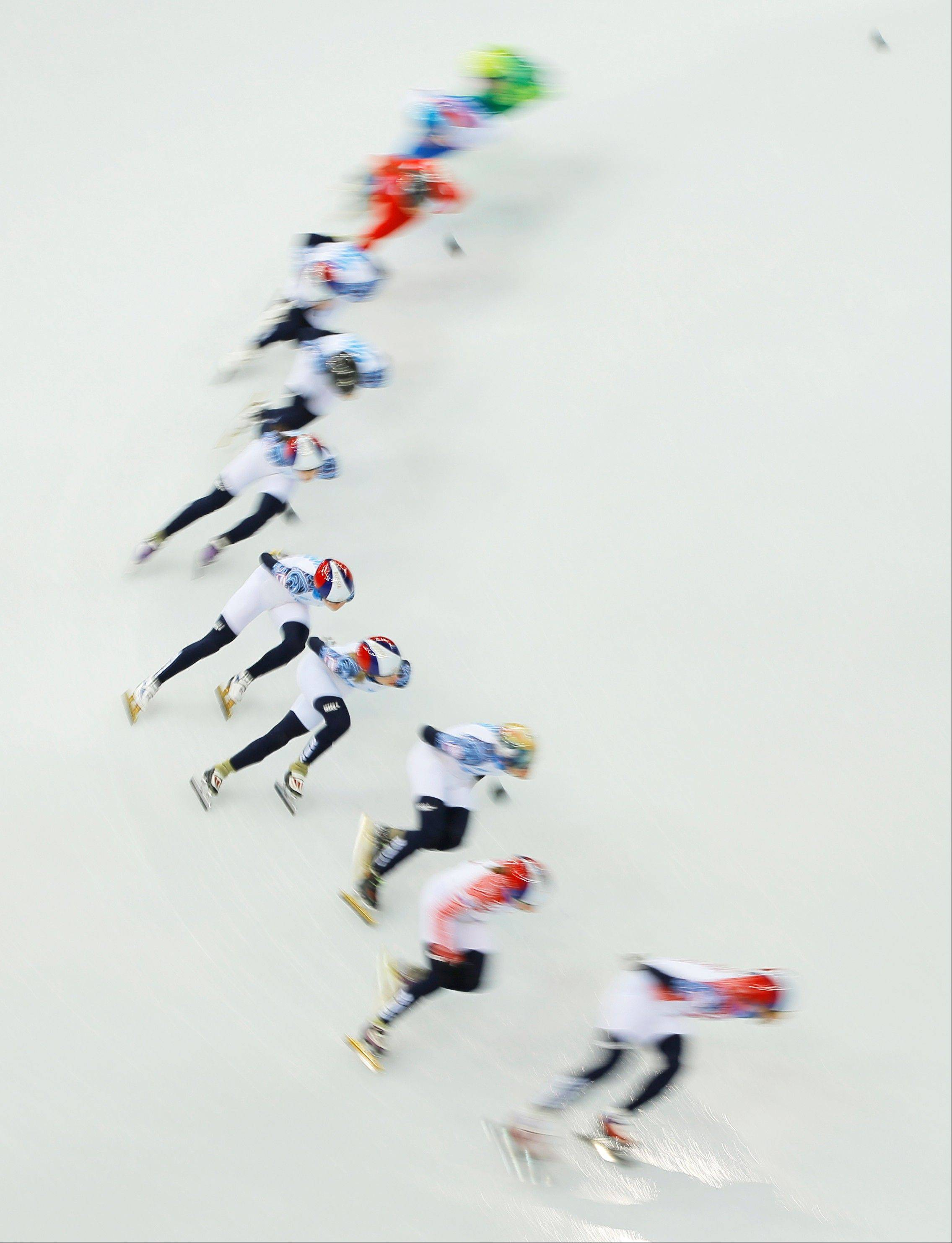 Skaters from Russia, Poland and Lithuania practice during a short track speedskating practice session at the Iceberg Skating Palace ahead of the 2014 Winter Olympics, Thursday, Feb. 6, 2014, in Sochi, Russia. (AP Photo/Vadim Ghirda)
