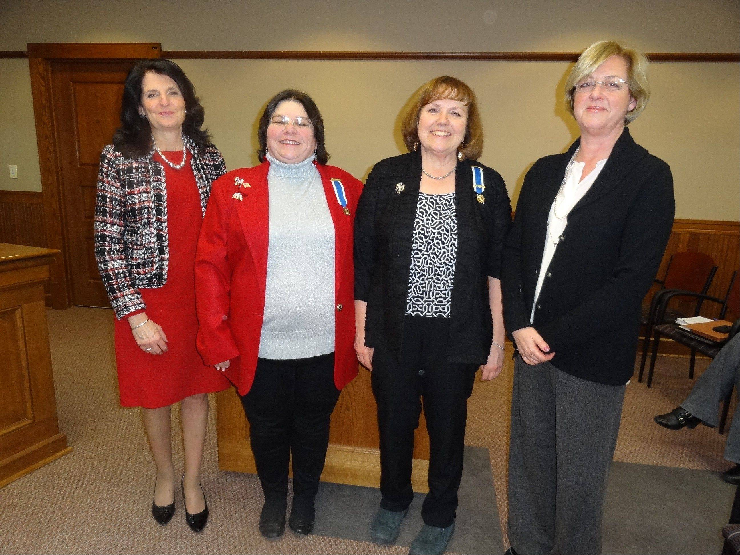 Village Board President Karen Darch, Signal Hill Chapter Regent Kathy Boyle, First Vice Regent Kathy Caseyand White House Board member Beth Raseman at the Jan. 13 Barrington Village Board meeting.
