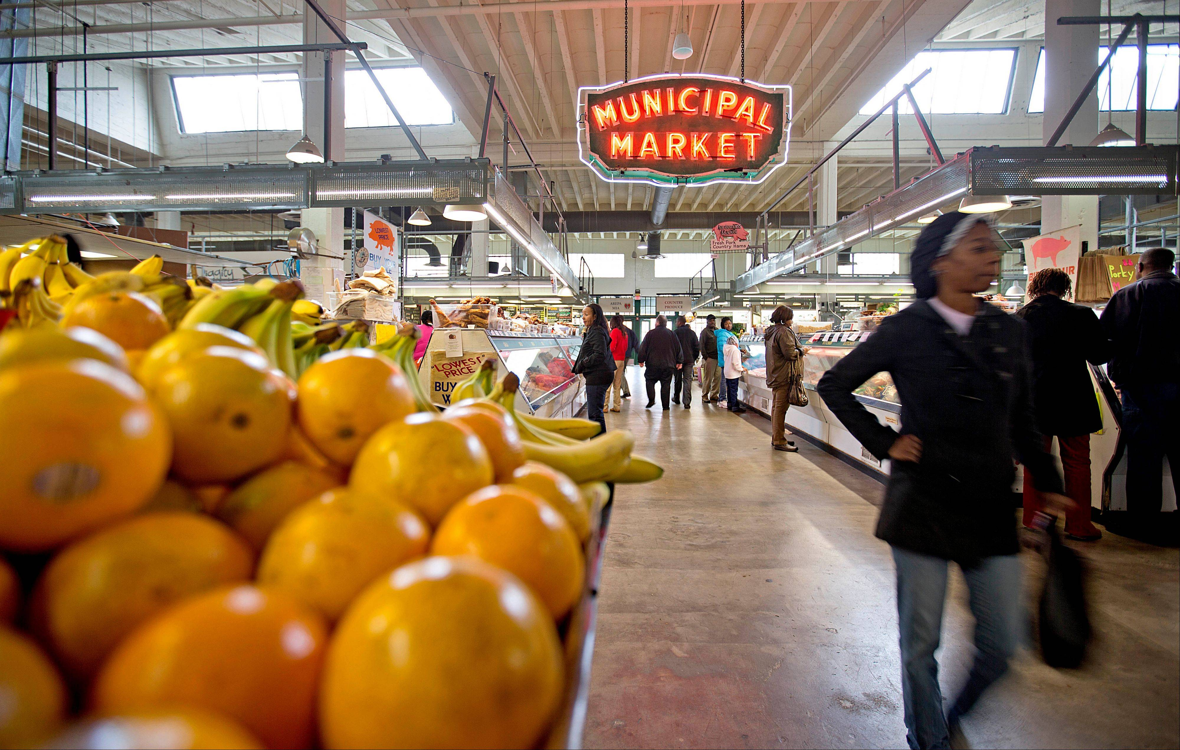 Associated Press/Dec. 20, 2013 Shoppers passing through the Sweet Auburn Curb Market in Atlanta. Look no further than your dinner plate to understand how the sweeping farm bill affects you.