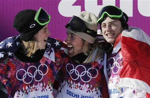 United States' Sage Kotsenburg, center, celebrates with Norway's Staale Sandbech, left, and Canada's Mark McMorris after Kotsenburg won the men's snowboard slopestyle final at the Rosa Khutor Extreme Park, at the 2014 Winter Olympics, Saturday, Feb. 8, 2014, in Krasnaya Polyana, Russia. Sandbech took the silver medal and McMorris took bronze.