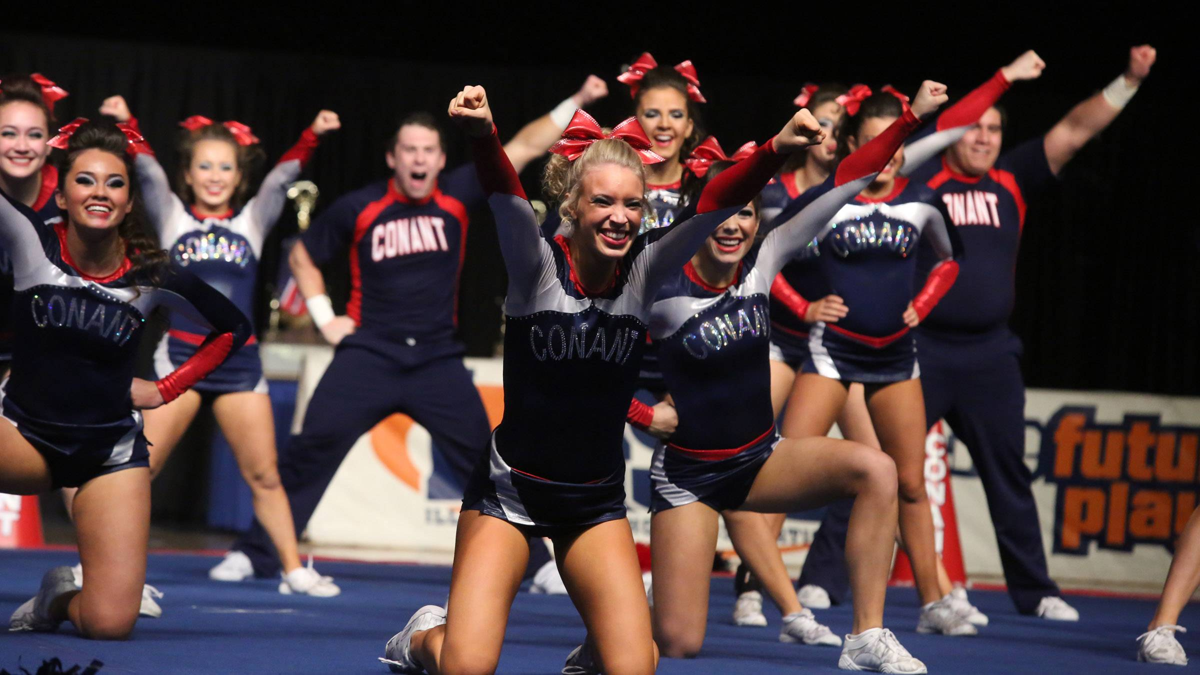 Conant High School's cheer team performs in the coed team category at the IHSA state finals on Saturday in Bloomington.