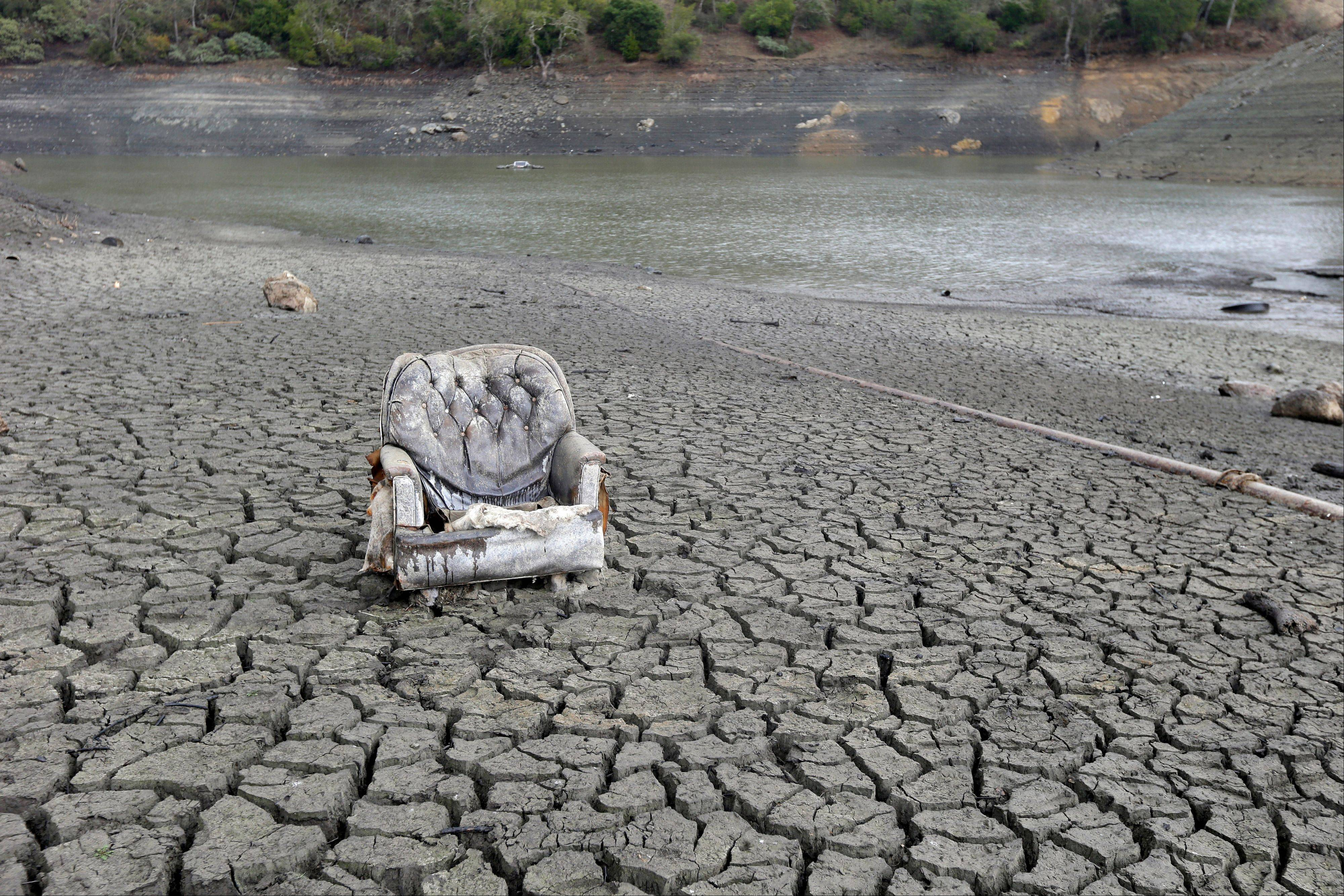 A chair sits exposed Friday on the cracked-dry bed of the Almaden Reservoir in San Jose, Calif.