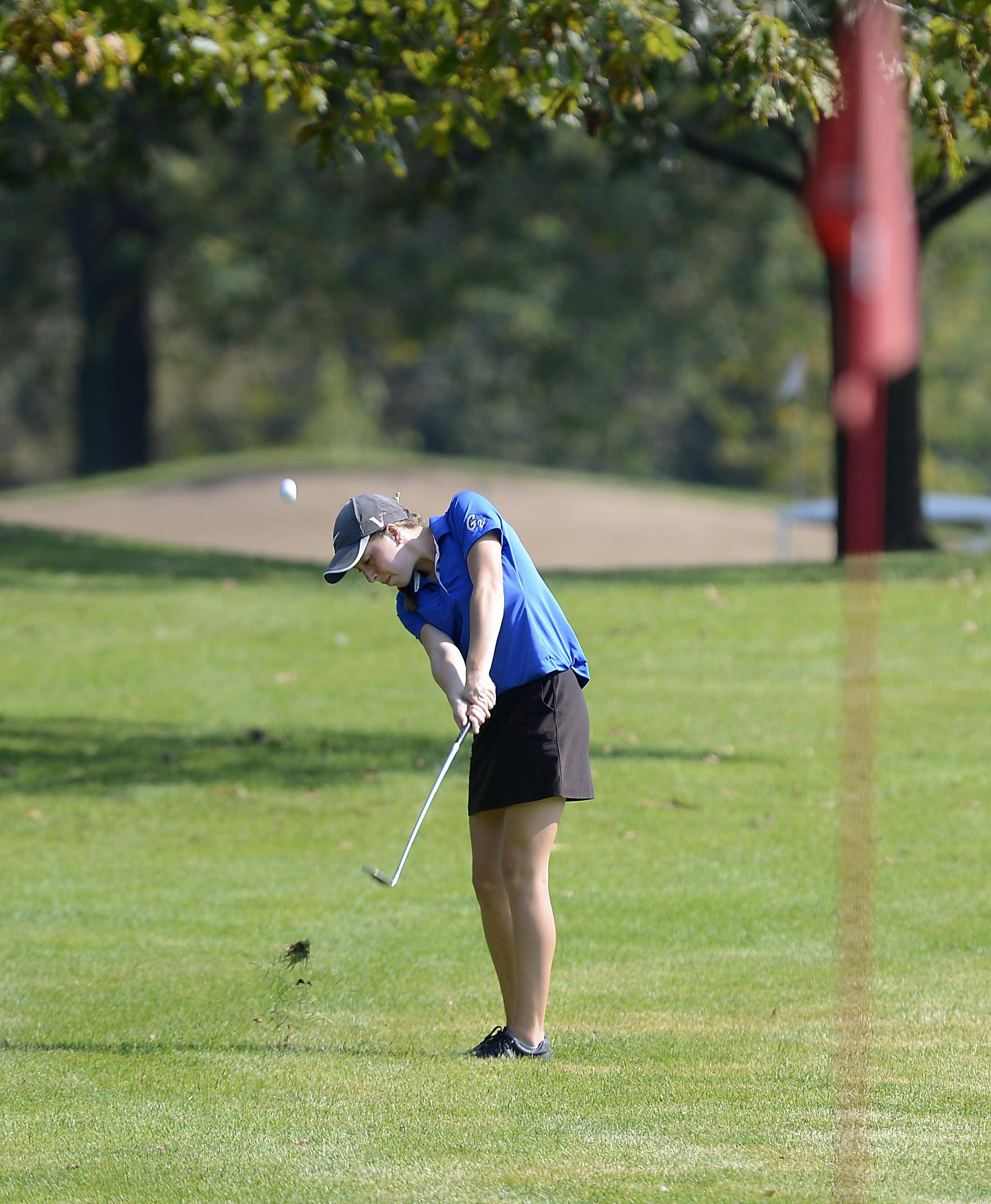 Geneva's Nicole Hassels hits from the fairway on #7 Monday at the Upstate Eight Conference girls golf tournament at St. Andrews Country Club in West Chicago.