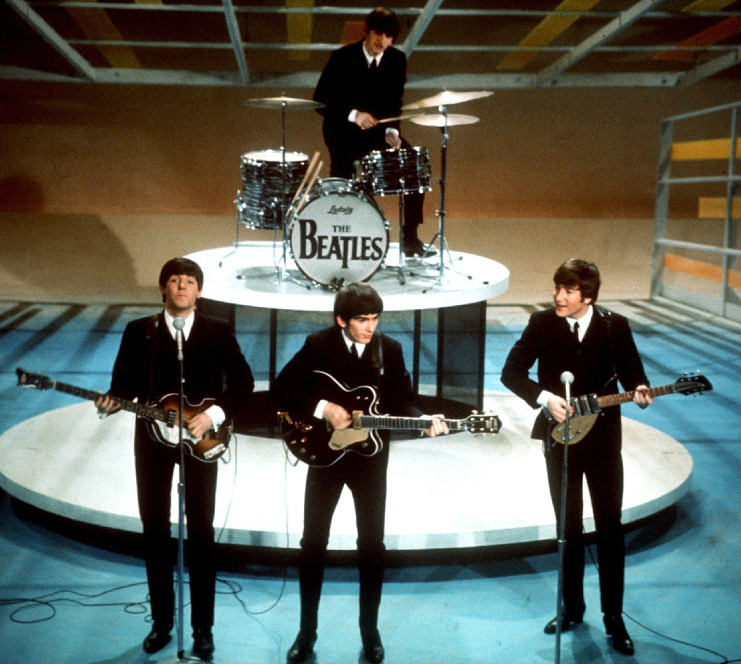 "In this Feb. 9, 1964, file photo, The Beatles, from left, Paul McCartney, George Harrison, Ringo Starr on drums, and John Lennon perform on the CBS ""Ed Sullivan Show"" in New York. The Beatles made their first appearance on ""The Ed Sullivan Show,"" America's must-see weekly variety show, on Sunday, Feb. 9, 1964, and officially kicked off Beatlemania."