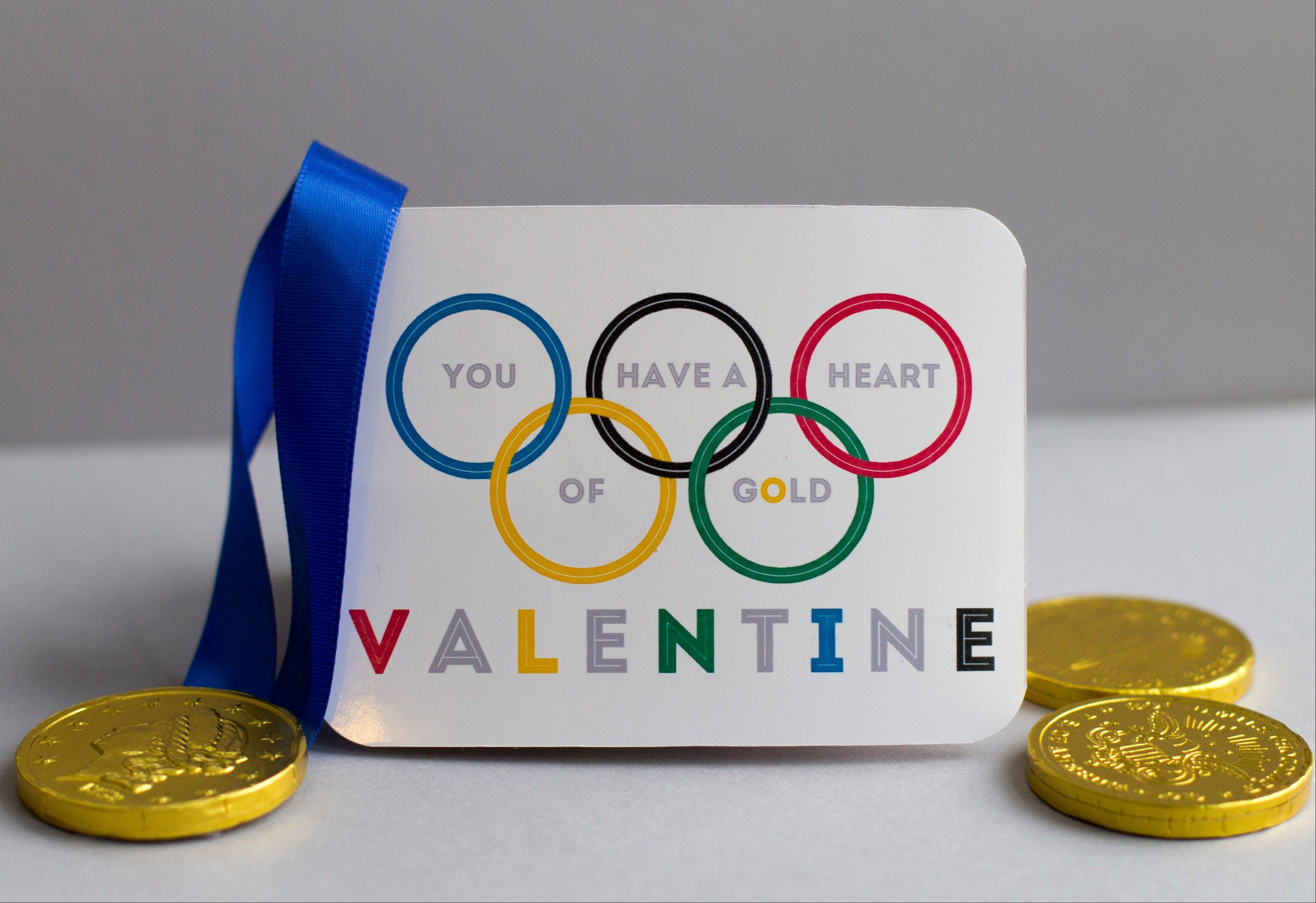 With Valentine's Day falling during the 2014 Winter Games, celebrate both with an Olympics-themed card and miniature gold medal.