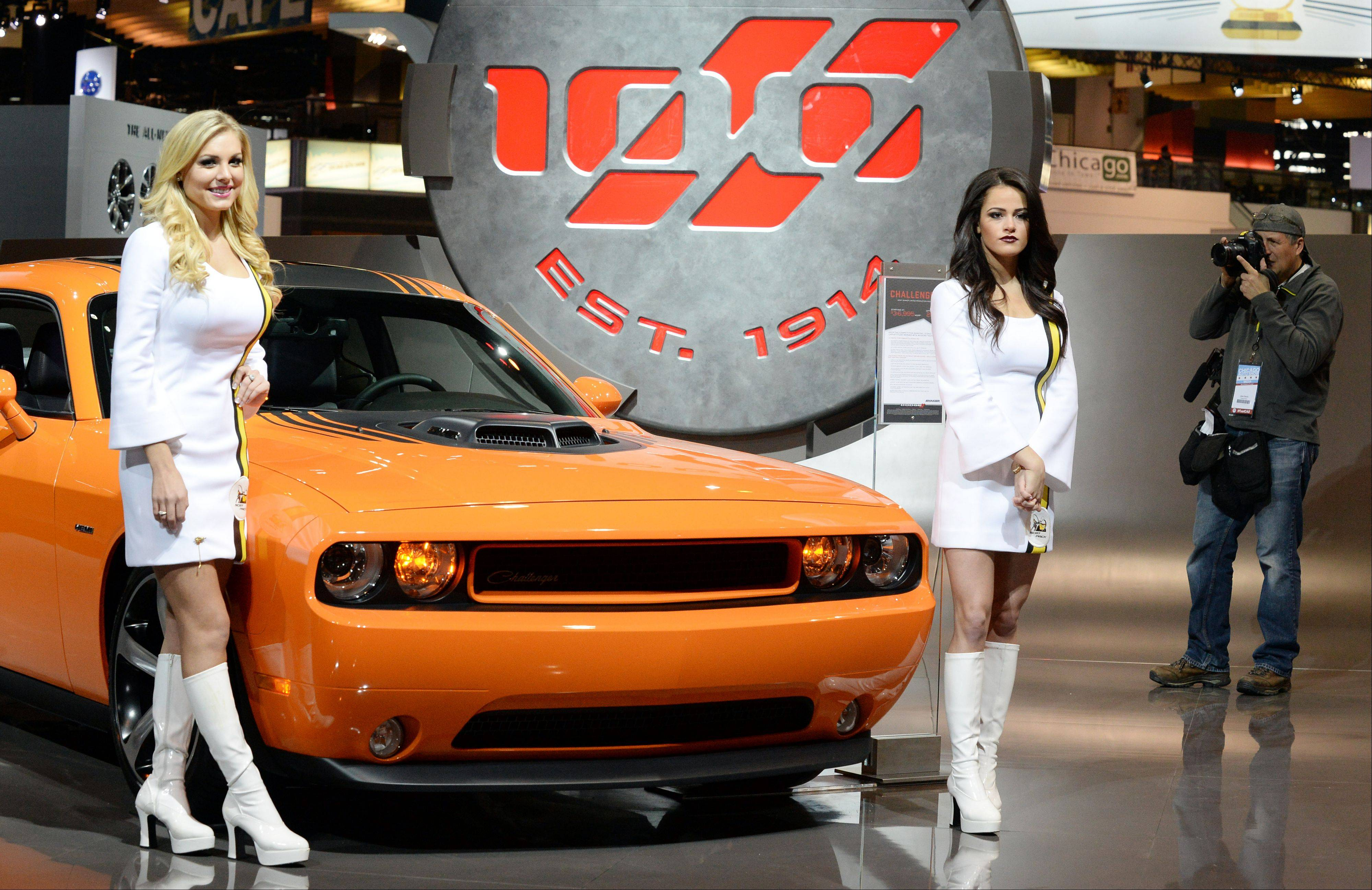 Cars and models at the Chicago Auto Show are both crowd pleasers.