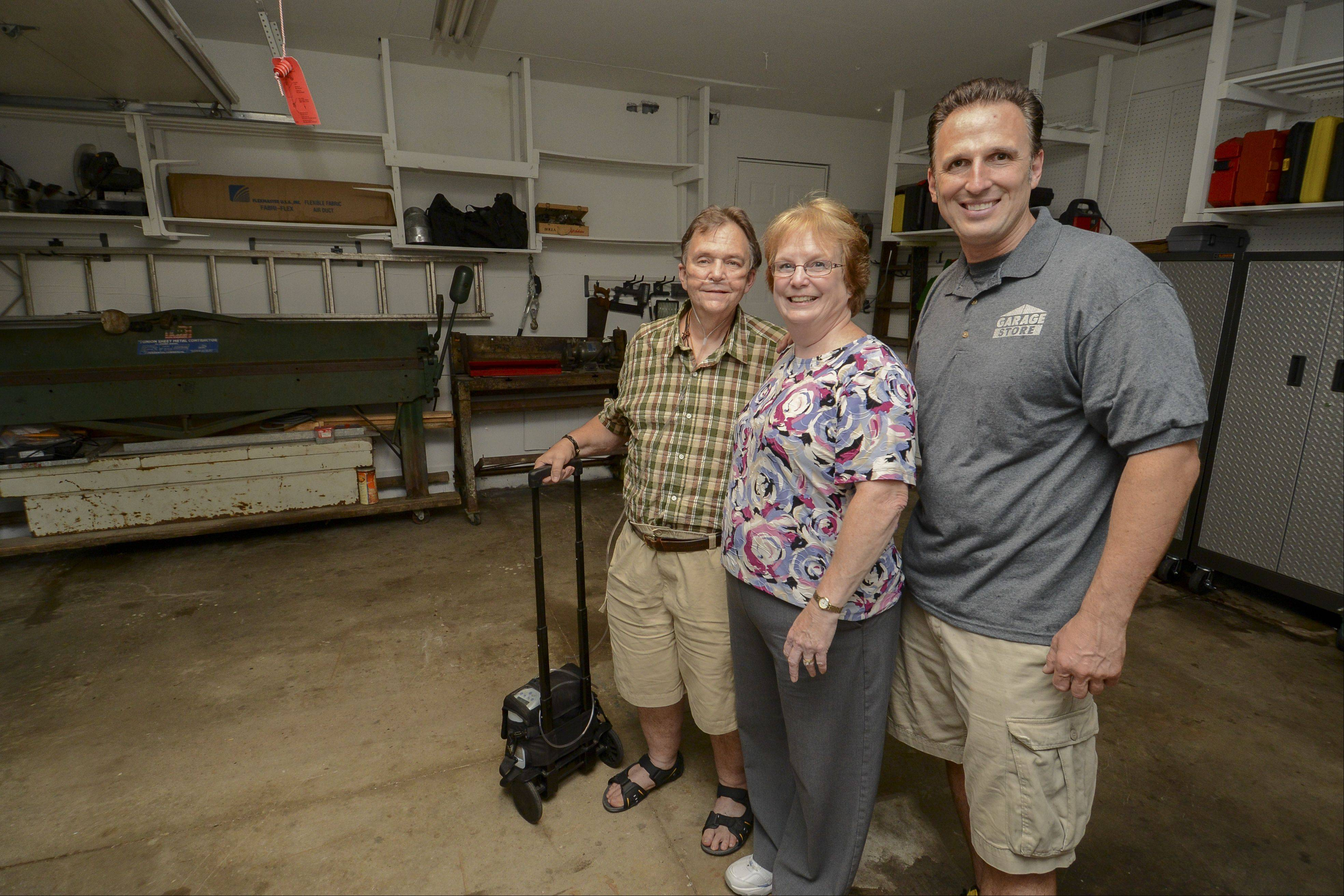Bob and Dianne DeBellis of Roselle, from left, last year won a garage makeover performed in part by Jim Melchert of the Garage Store.