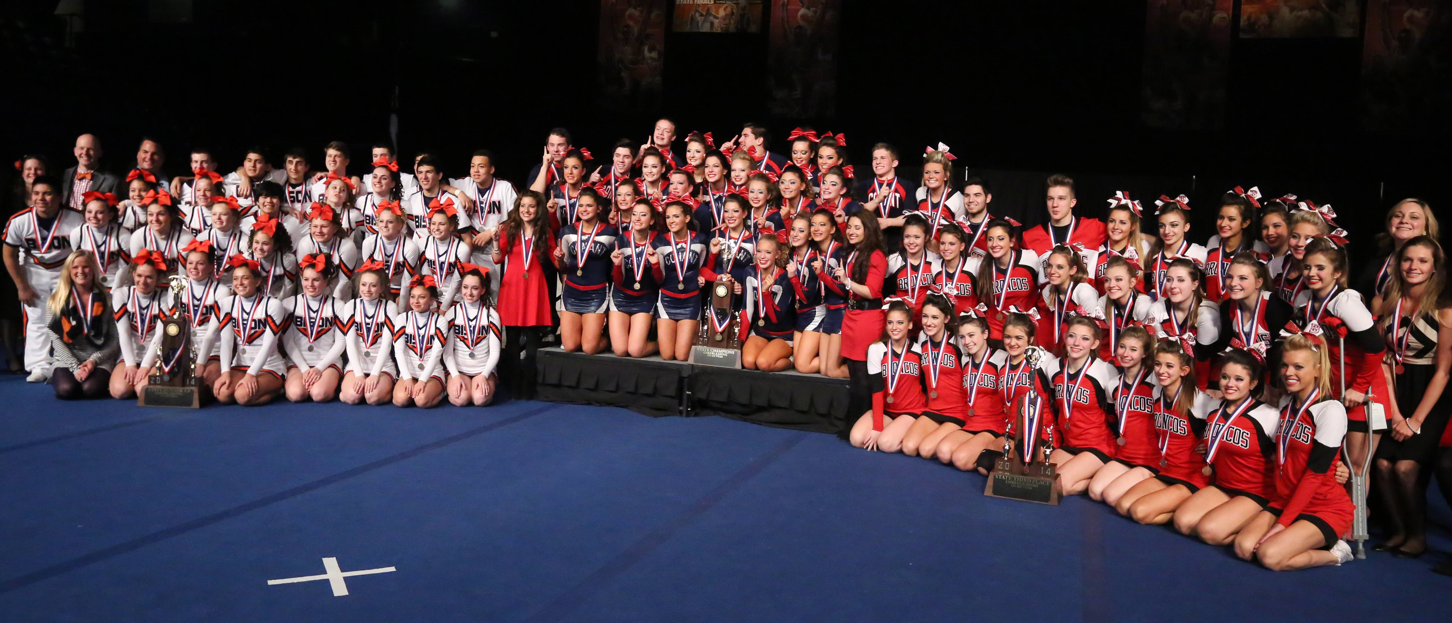 Suburban high school cheer teams swept the coed category at the IHSA cheer finals in Bloomington on Saturday. In the center is Conant with the first place trophy, at left is Buffalo Grove with the second place trophy and at right is Barrington with the 3rd place trophy.