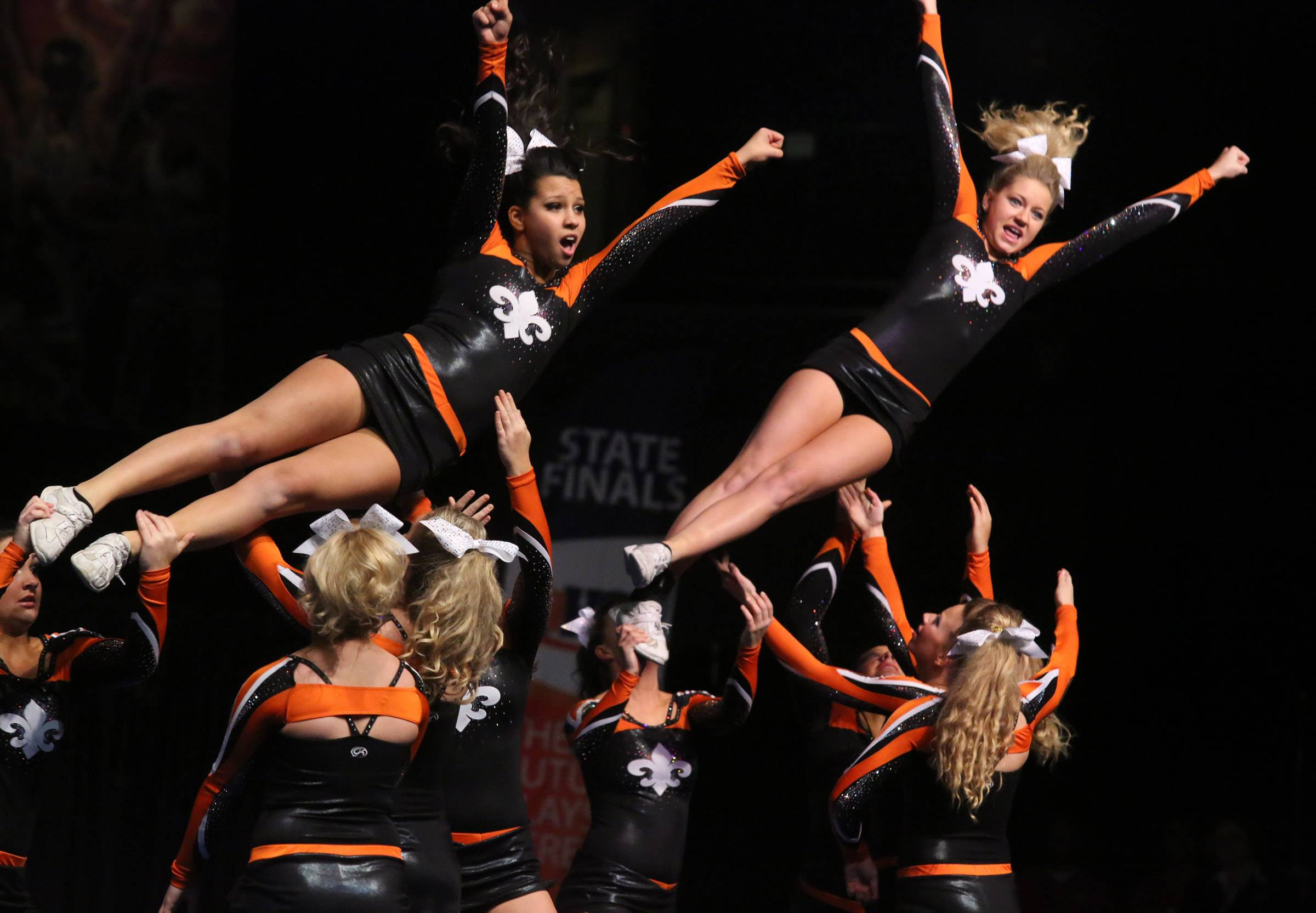 St. Charles East High School's cheer team performs in the large team category at the IHSA state finals on Saturday in Bloomington.