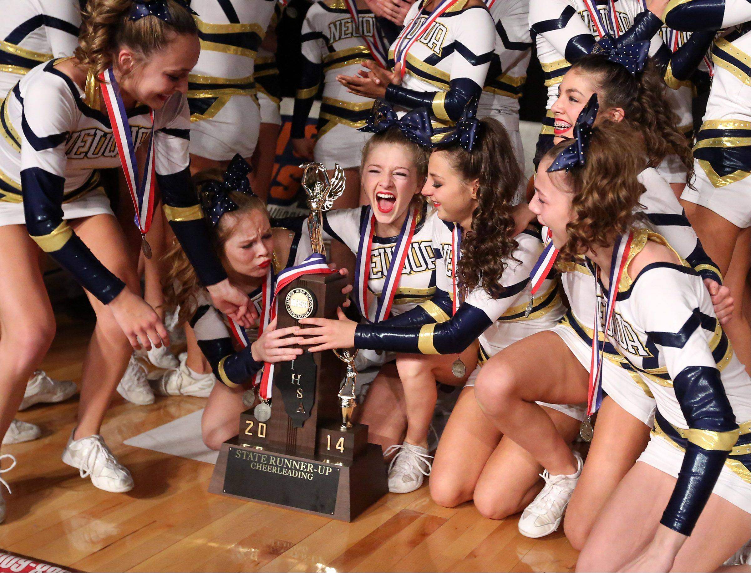 Neuqua Valley celebrates taking third place in the large team category at the IHSA state finals on Saturday in Bloomington.