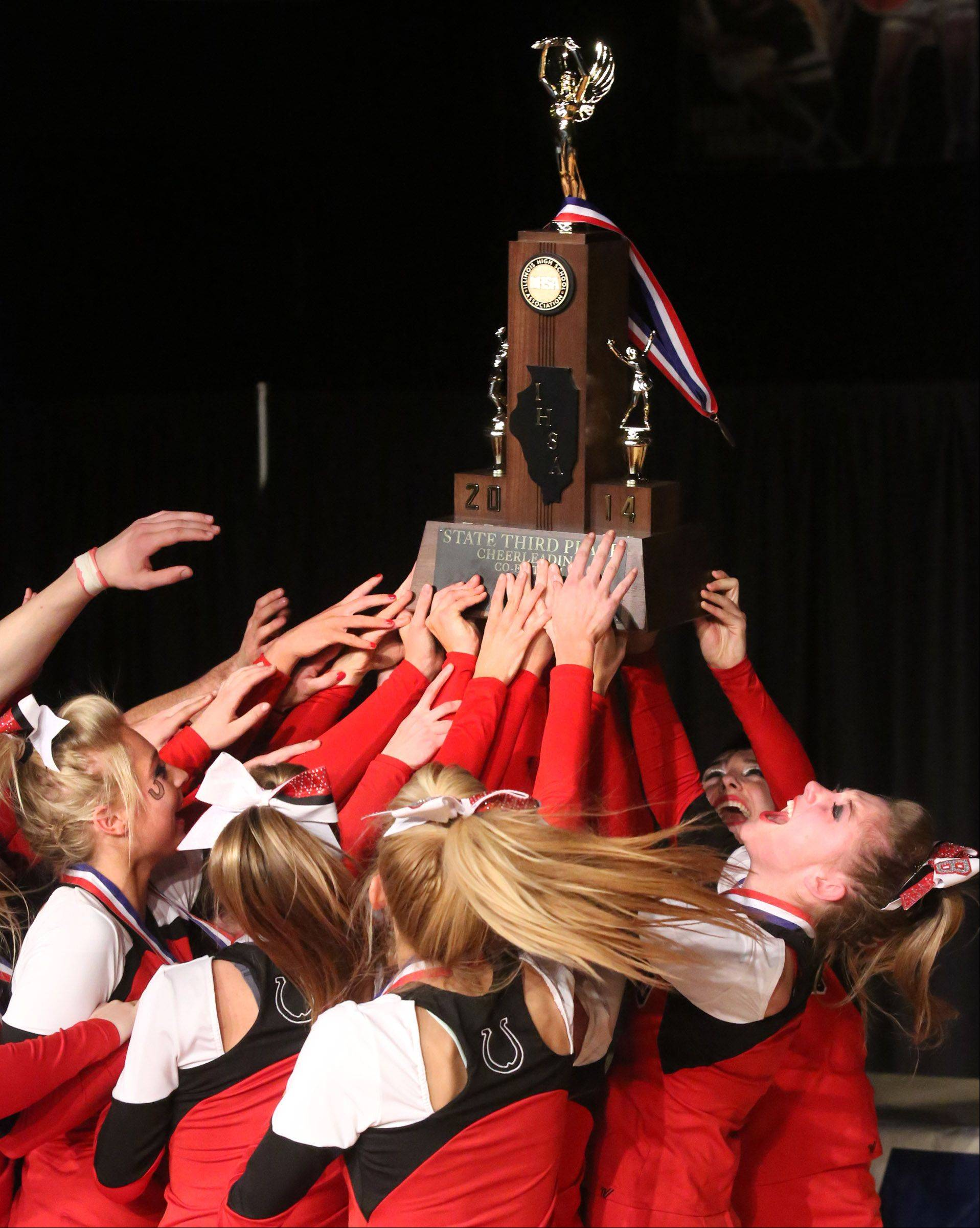 Barrington High School's cheer team celebrates taking third place in the coed team category at the IHSA state finals on Saturday in Bloomington.