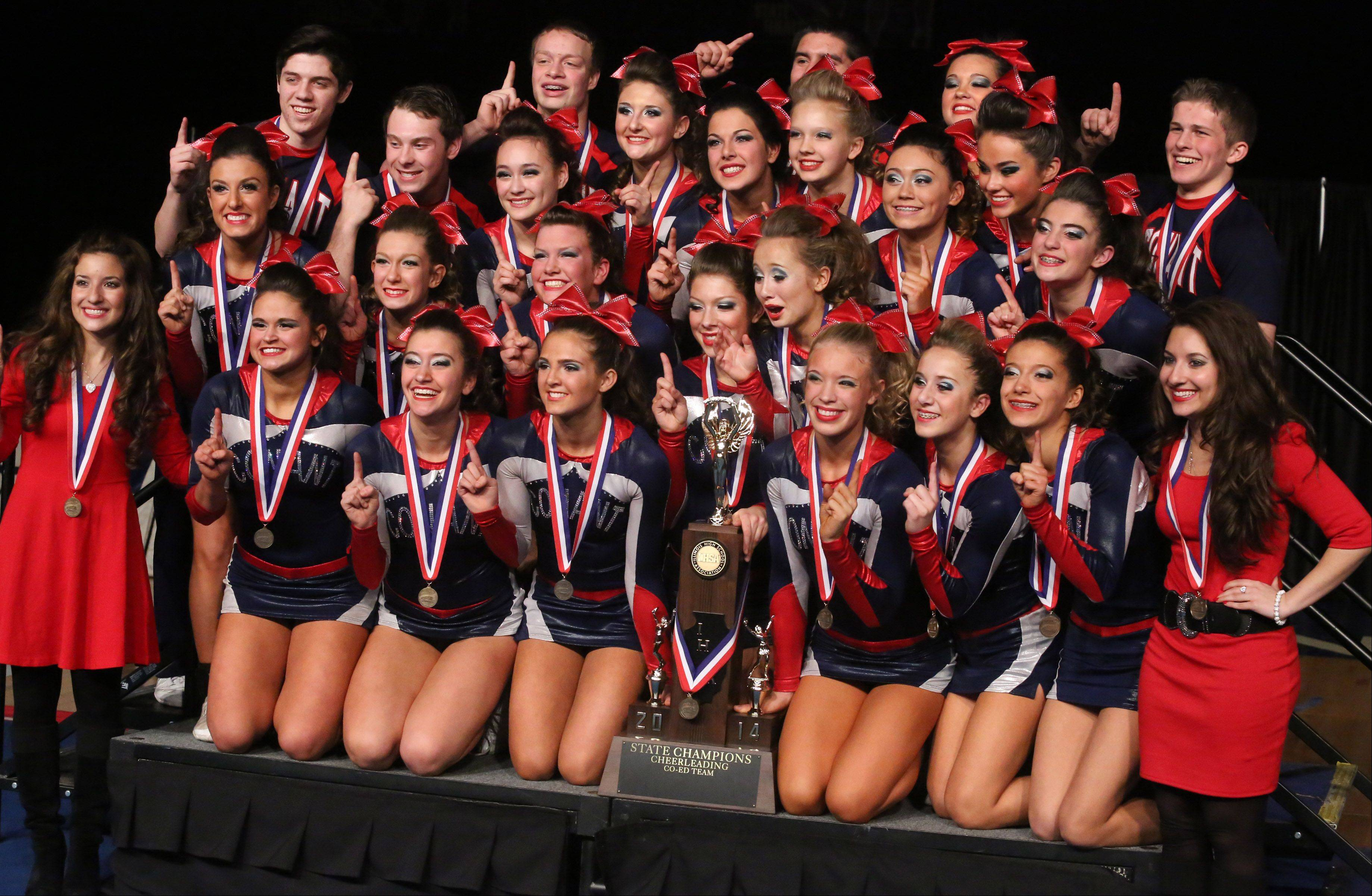 Conant cheer team with the first place in the coed team category at the IHSA state finals on Saturday in Bloomington.