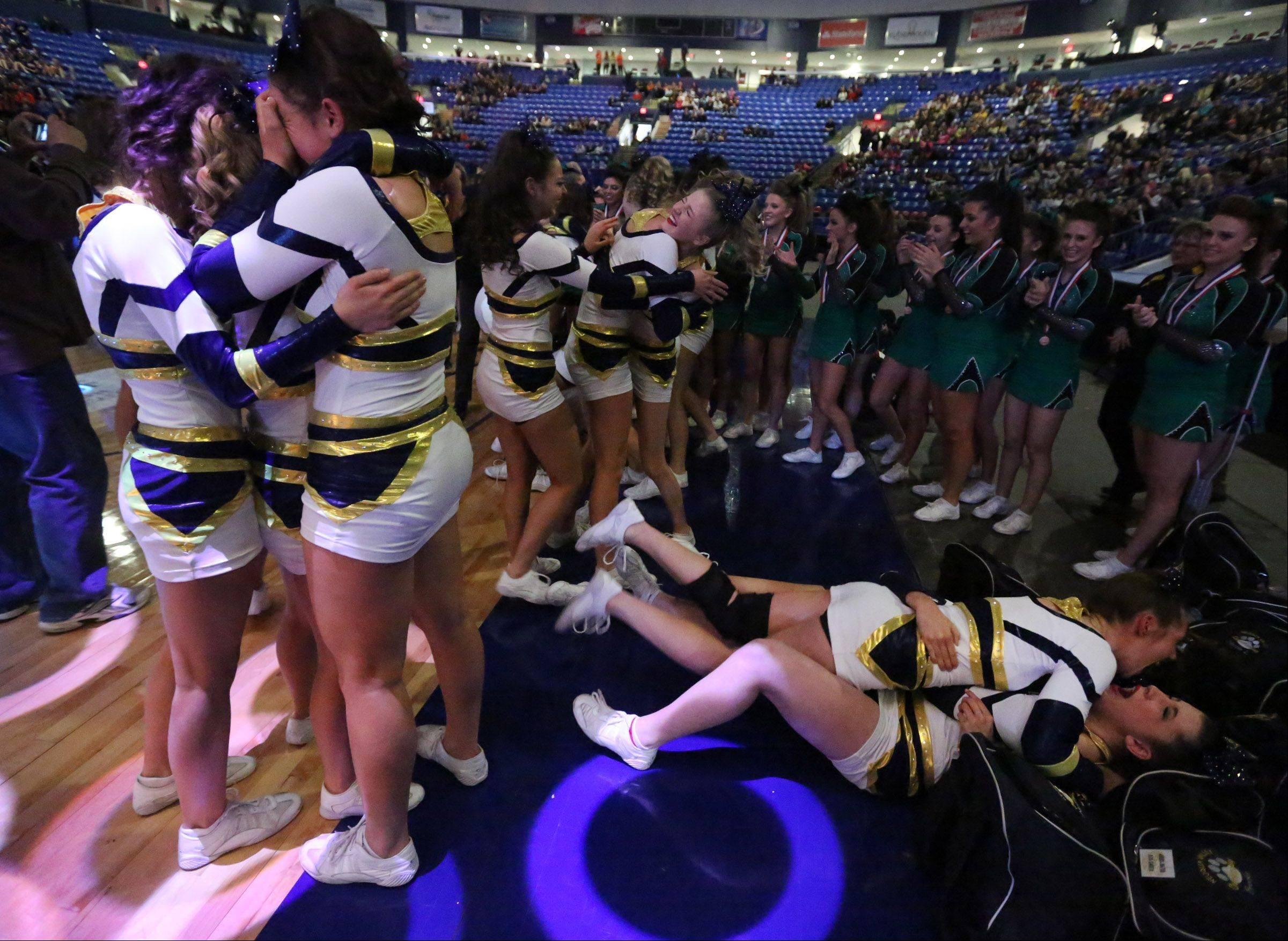Neuqua Valley reacts to the announcement that they took third place in the large team category at the IHSA state finals on Saturday in Bloomington.