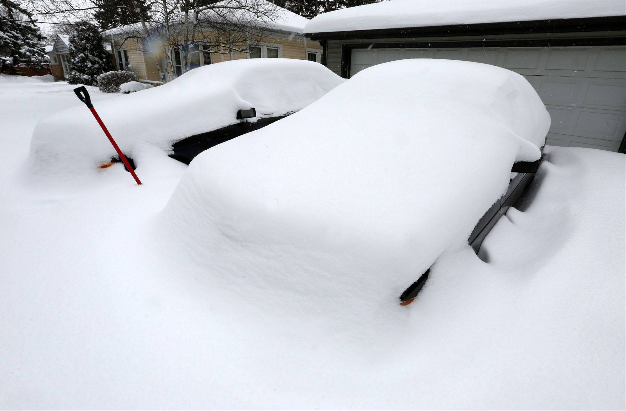 George LeClaire/gleclaire@dailyherald.comTwo cars stayed buried in snow at noon on Thursday in Des Plaines.