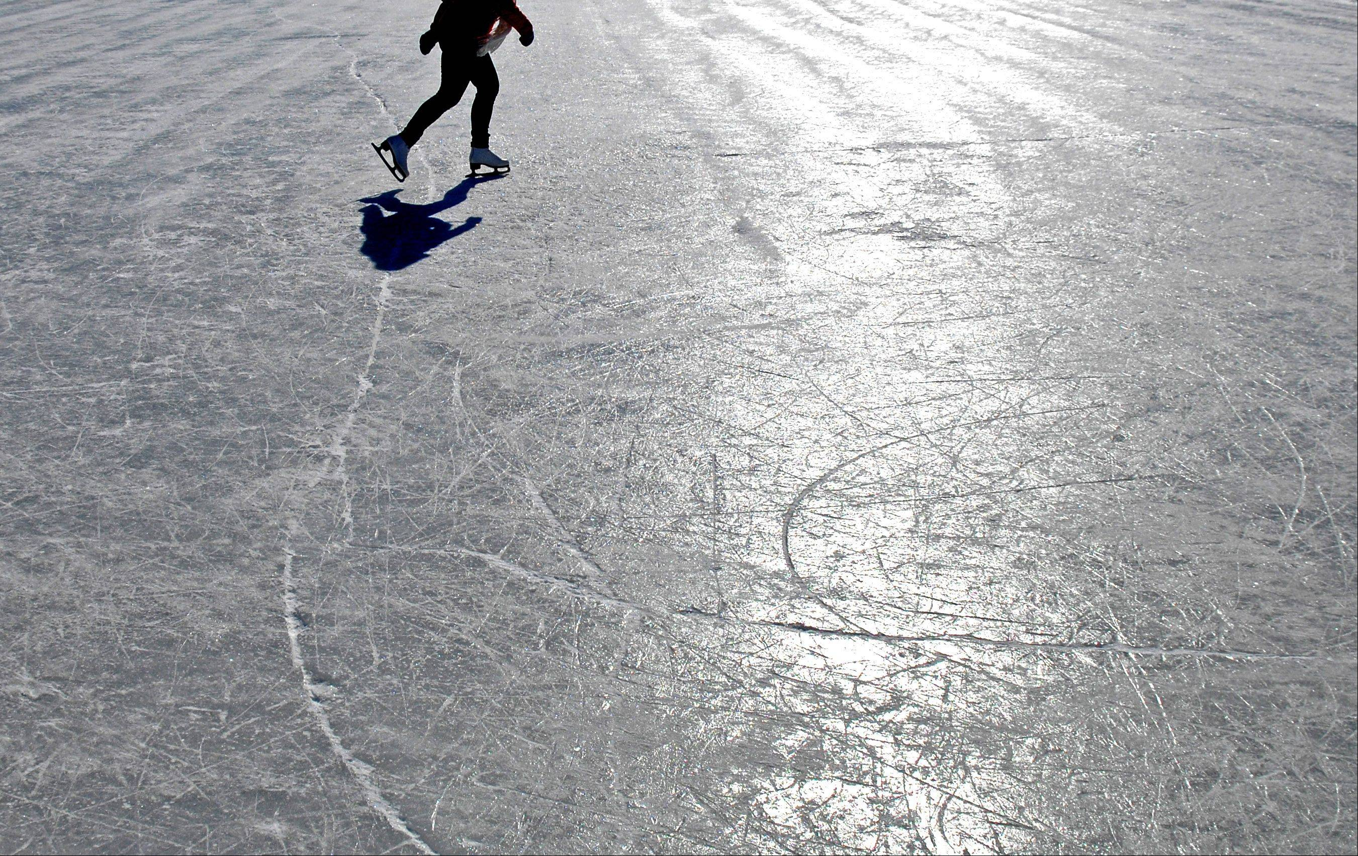 "Ellie DeFoy, of Batavia, gets the ice all to herself as she skates at Depot Pond in Batavia Monday. Despite a temperature of about 10 degrees, the lack of wind and sunshine made it more comfortable. ""The sun feels so warm, it's gorgeous out here,"" she said."