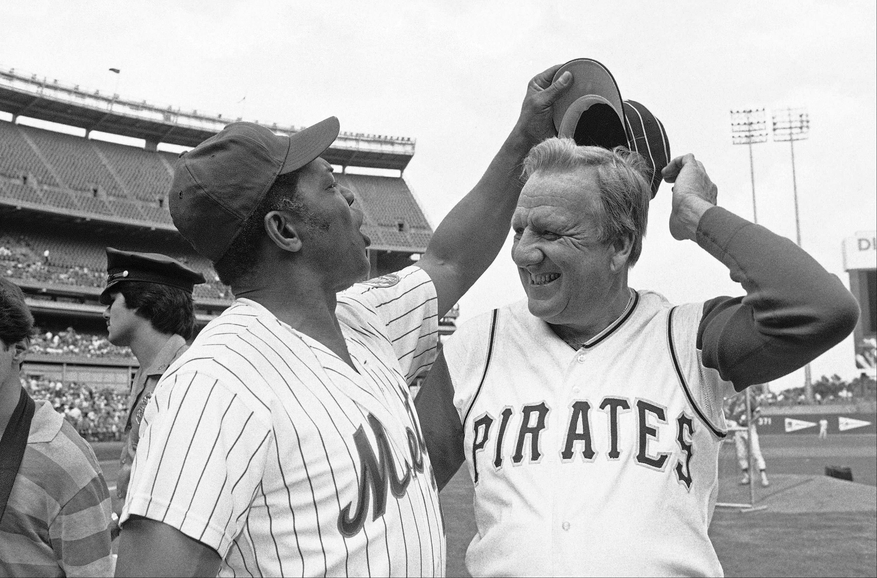 Willie Mays tries to get Ralph Kiner's hat as the two Hall of Famers pose for pictures before the start of Old Timers Day game at Shea Stadium in New York.