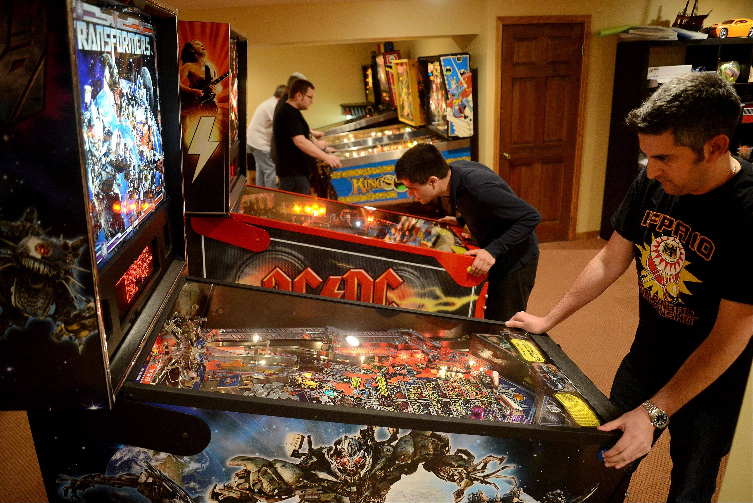 Josh Sharpe of Palatine, right, and Joseph Blasi of Des Plaines practice Saturday at the International Flipper Pinball Association tournament in Lincolnshire.