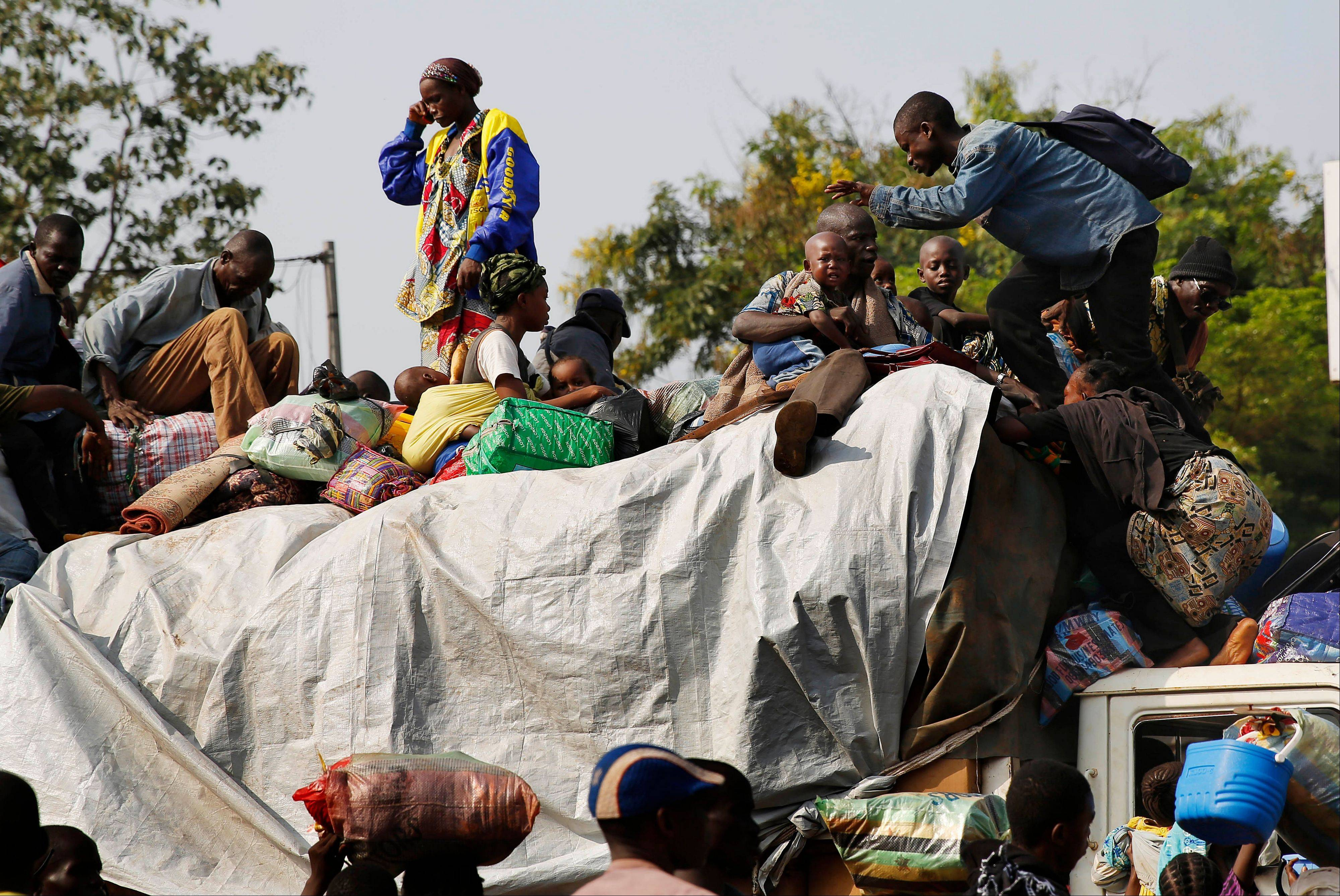 At PK12, the last checkpoint at the exit of the town, thousands of Muslim residents flee from Bangui and Mbaiki.