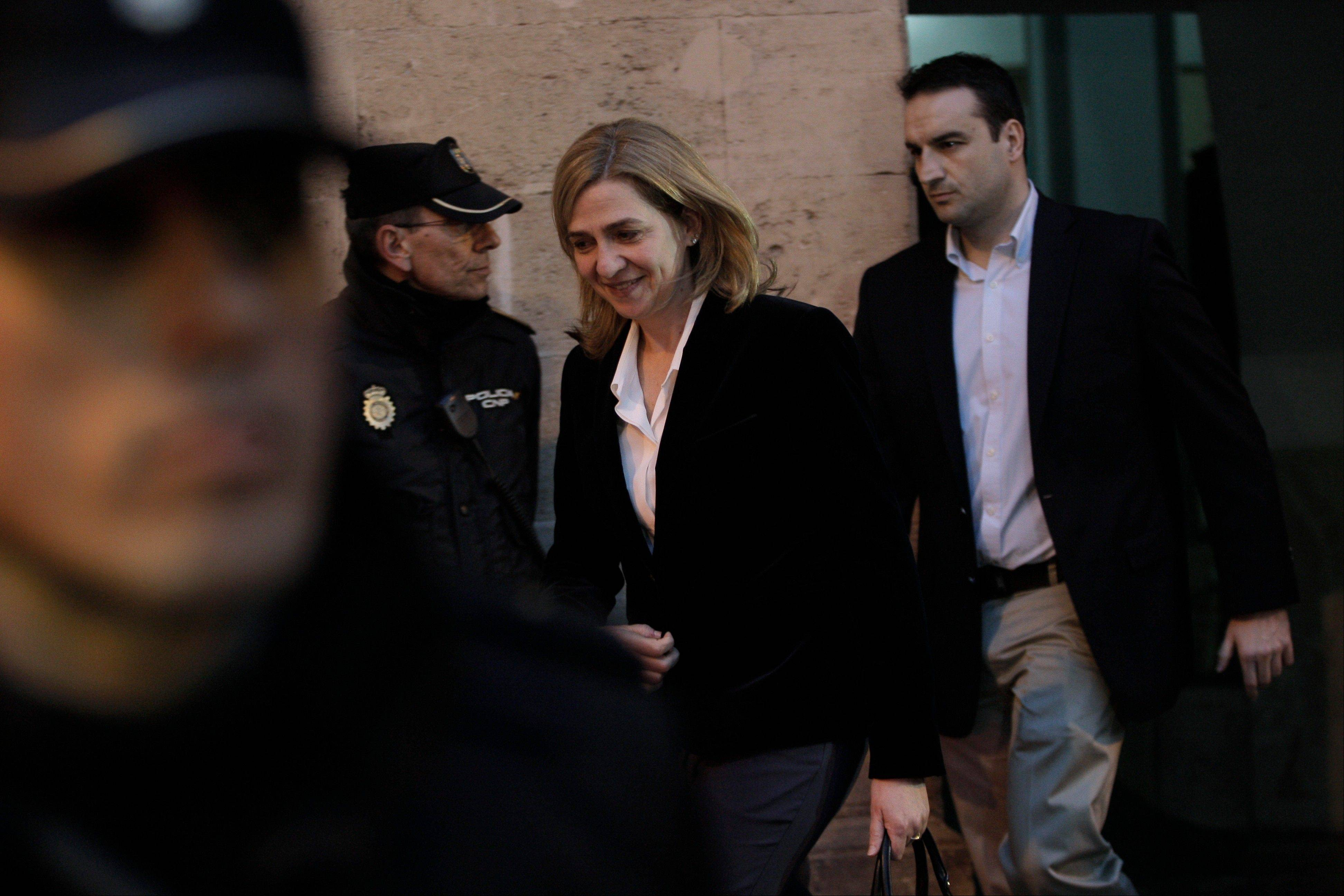 Spain's Princess Cristina, center, leaves the courthouse Saturday in Palma Mallorca, Spain. Cristina testified in court during a historic judicial hearing to help determine whether she and her husband illegally used funds from a company to pay for expenses, including expensive parties at their modernist Barcelona mansion.