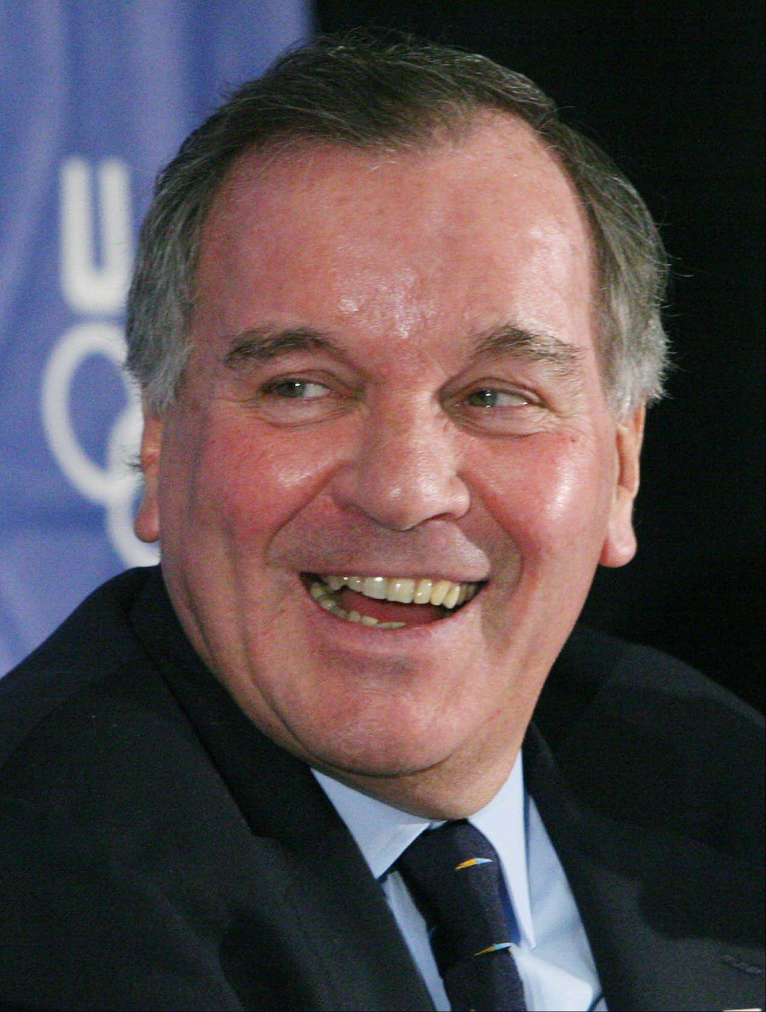 Chicago Mayor Richard M. Daley smiles as he speaks with reporters after Chicago's presentation to the U.S. Olympic Committee, in Washington.