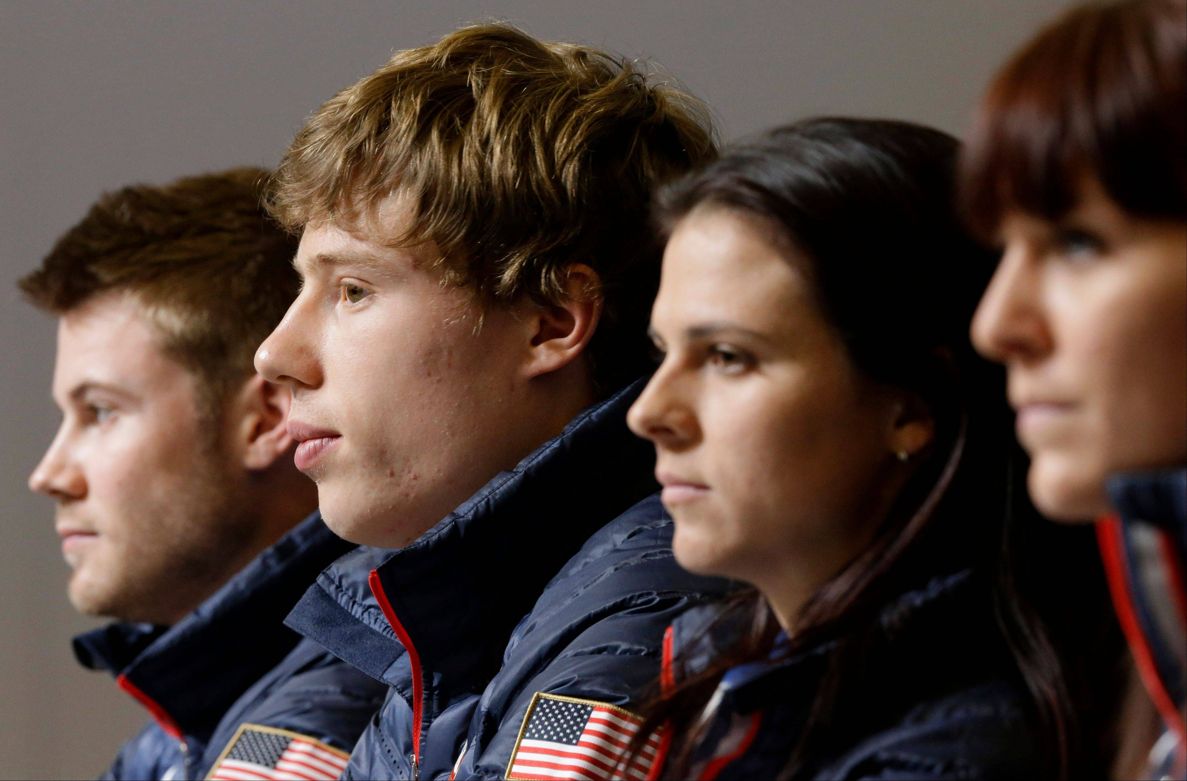 U.S. speedskaters Joey Mantia, from left, Brian Hansen, Brittany Bowe and Heather Richardson listen to a reporter's question during a 2014 Winter Olympics news conference, in Sochi, Russia.