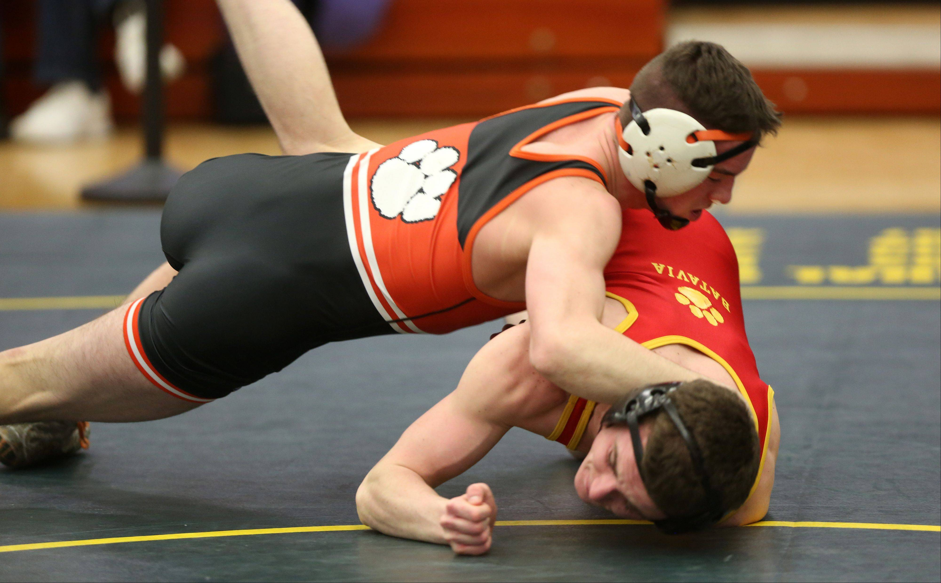 Wheaton Warrenville South's Qarin Johnnic works towards an eventual pin over Batavia's Marc Goodin during regional wrestling at Waubonsie Valley High School.