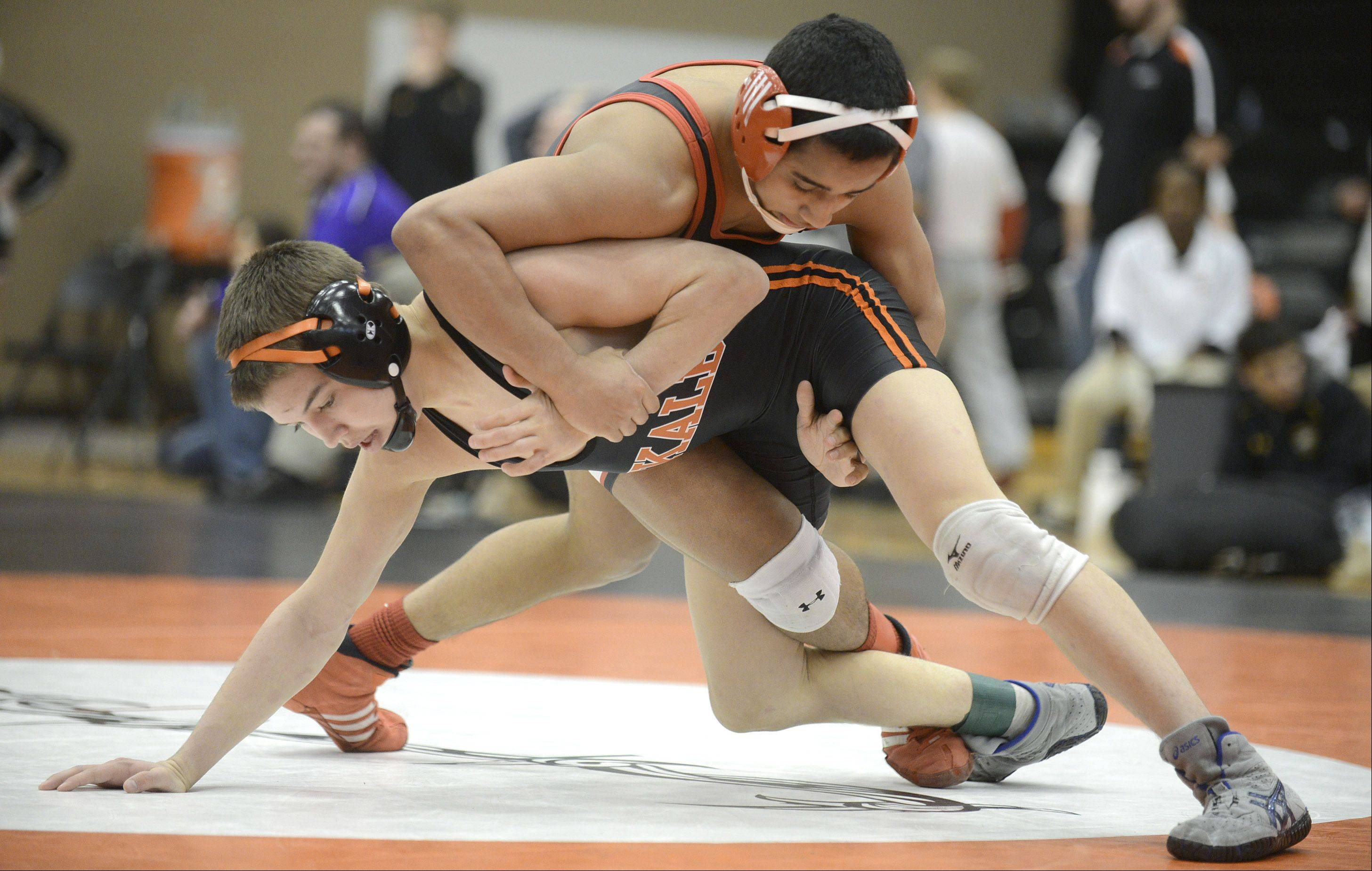 Huntley's Ricky Vigil takes the 126-pound match over DeKalb's Parker Stratton in the regional at DeKalb High School on Saturday.