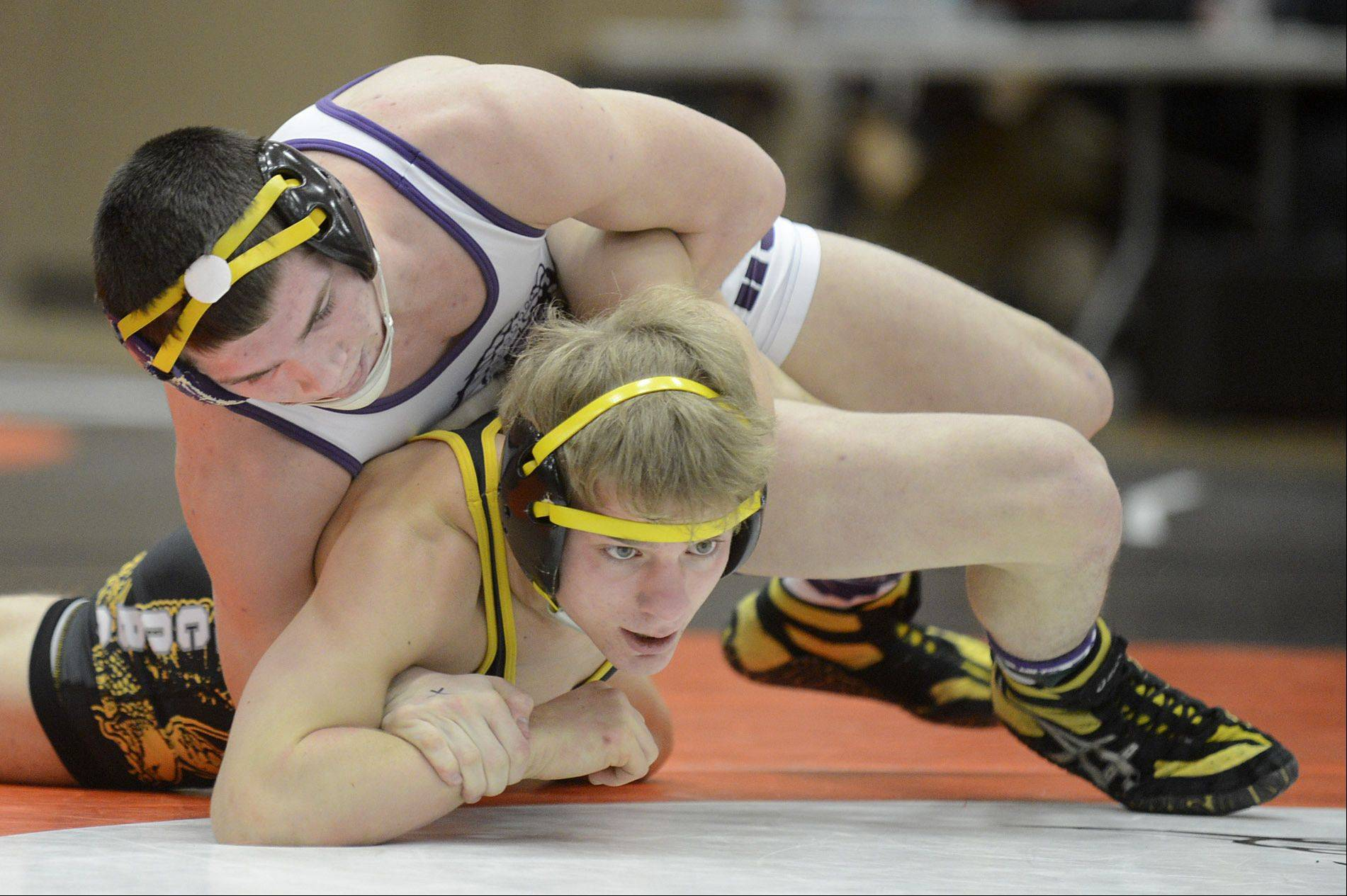 Hononegah's Keegan Powers and Jacobs' Cody Ferencz in the 120-pound match in the regional at DeKalb High School on Saturday. Powers won the match.