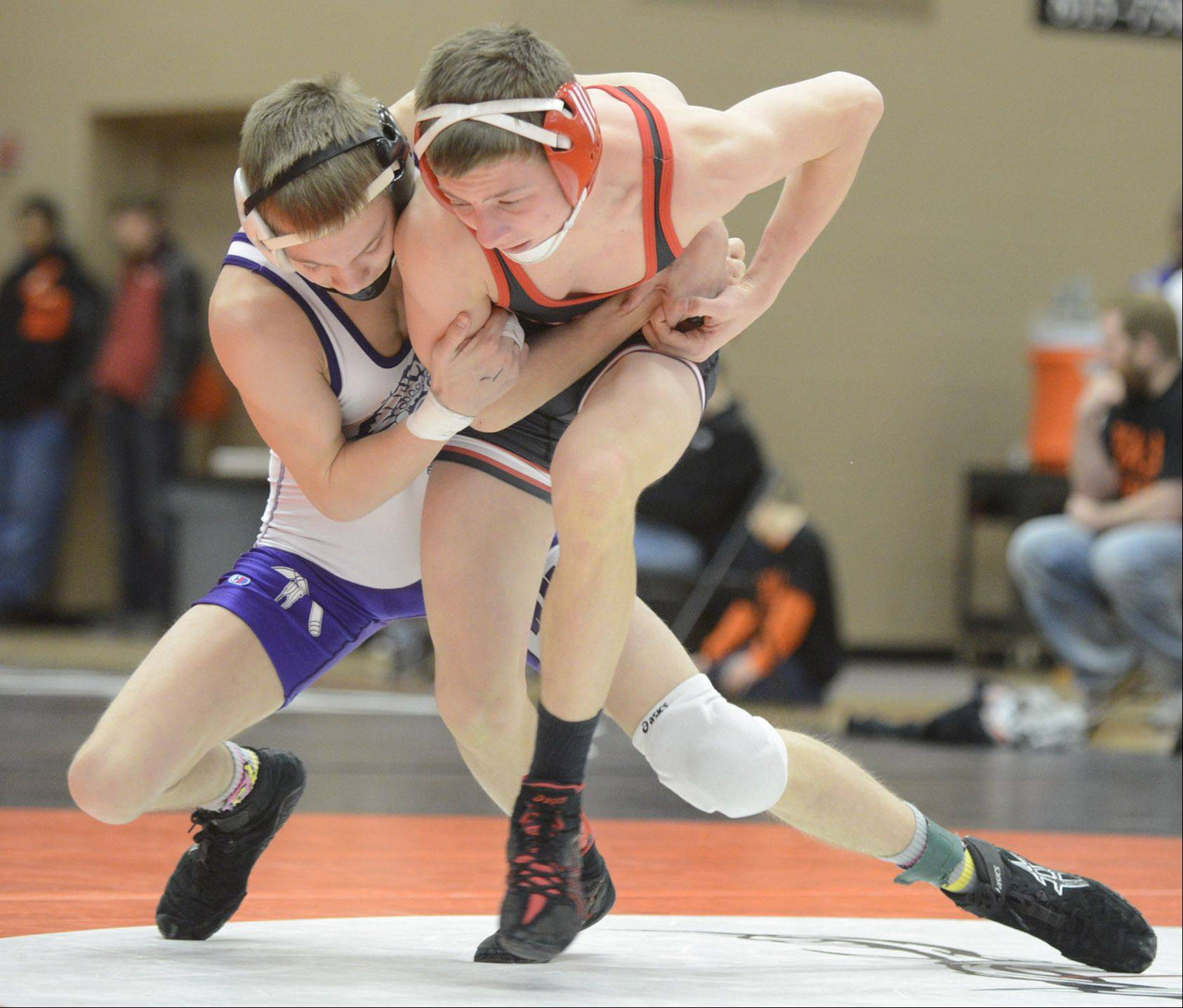 Hononegah's Brady Powers wraps up Huntley's Nick Meyer in the 113-pound match in the regional at DeKalb High School on Saturday.