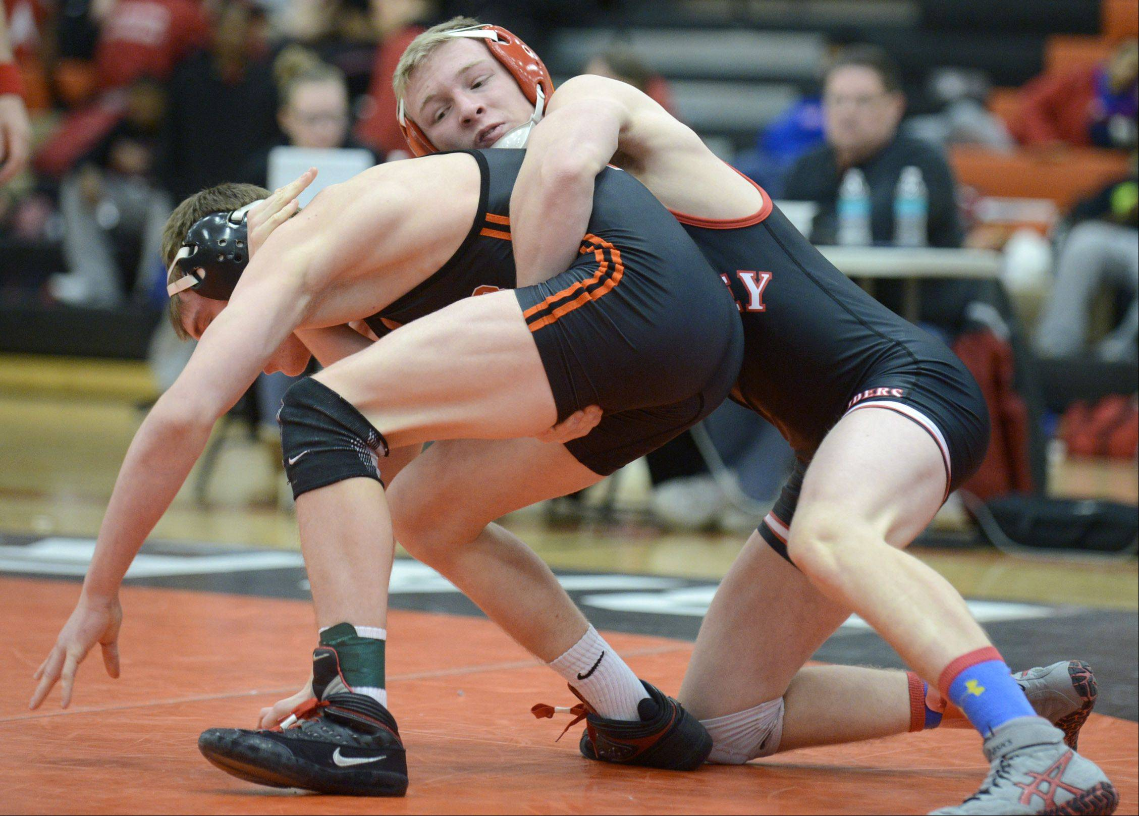 Huntley's Brandon Meyer takes the 138-pound match over DeKalb's Brad Green in the regional at DeKalb High School on Saturday.