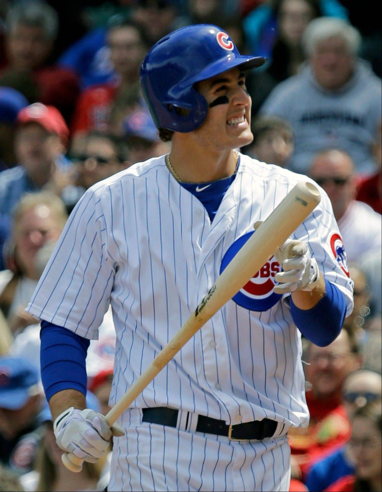 Anthony Rizzo reacts after striking out against the Reds last season. Rizzo's on-base percentage last year was .323.