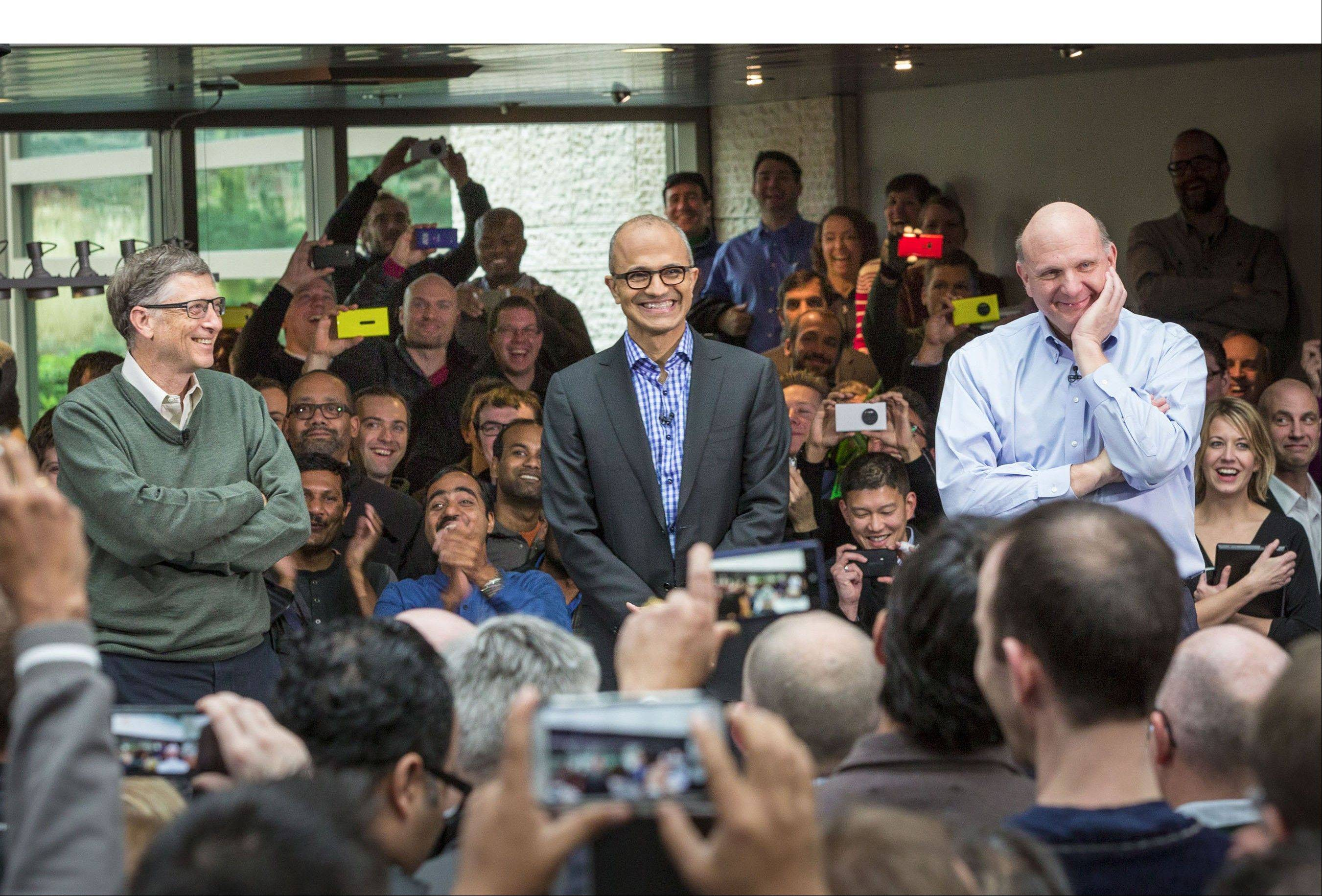 Satya Nadella, Microsoft�s new CEO, addresses employees along with Bill Gates and Steve Ballmer on the company�s Redmond, Wash., campus.