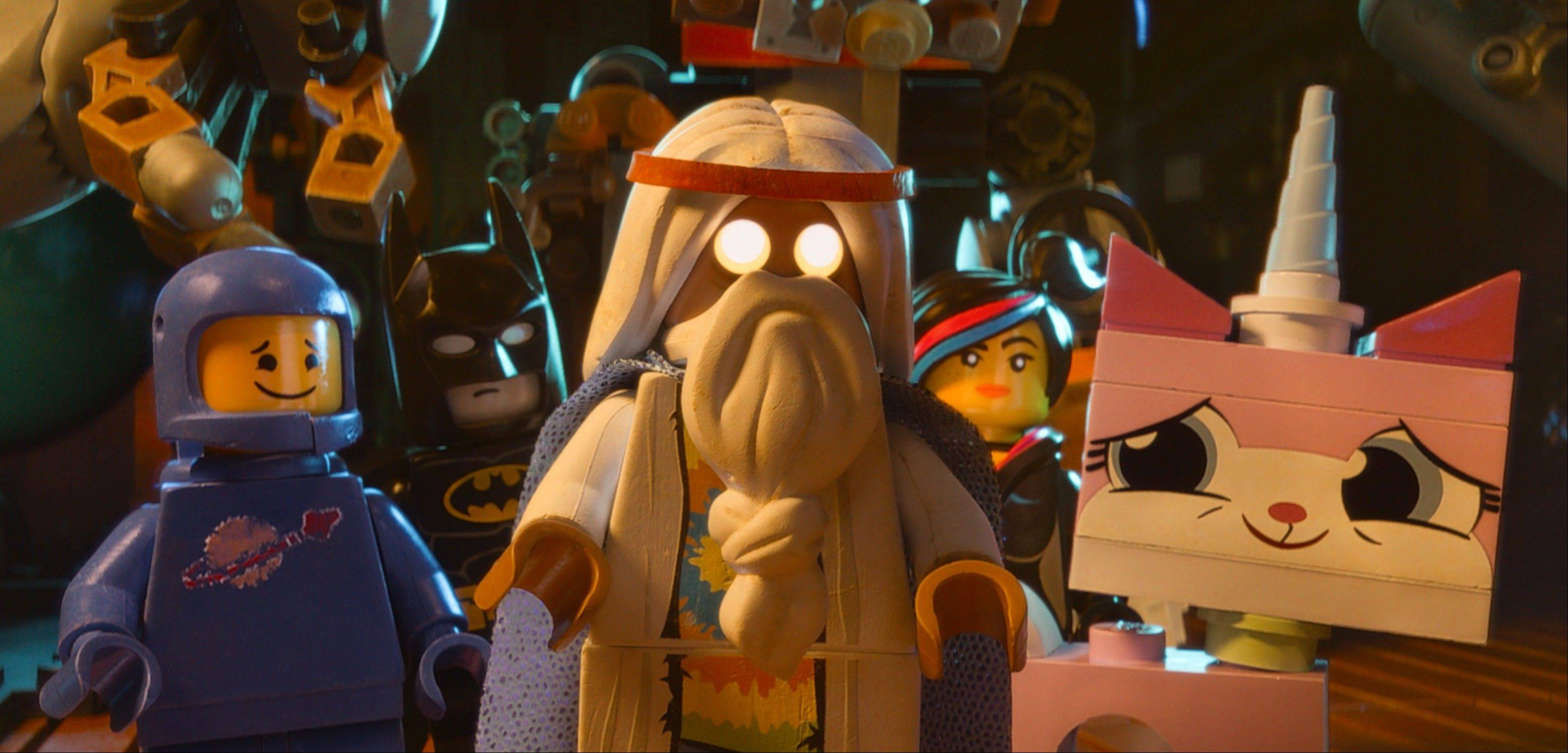 "Benny, voiced by Charlie Day, Batman, voiced by Will Arnett, Vitruvius, voiced by Morgan Freeman, Wyldstyle, voiced by Elizabeth Banks and Unikitty, voiced by Alison Brie, star in ""The Lego Movie."""