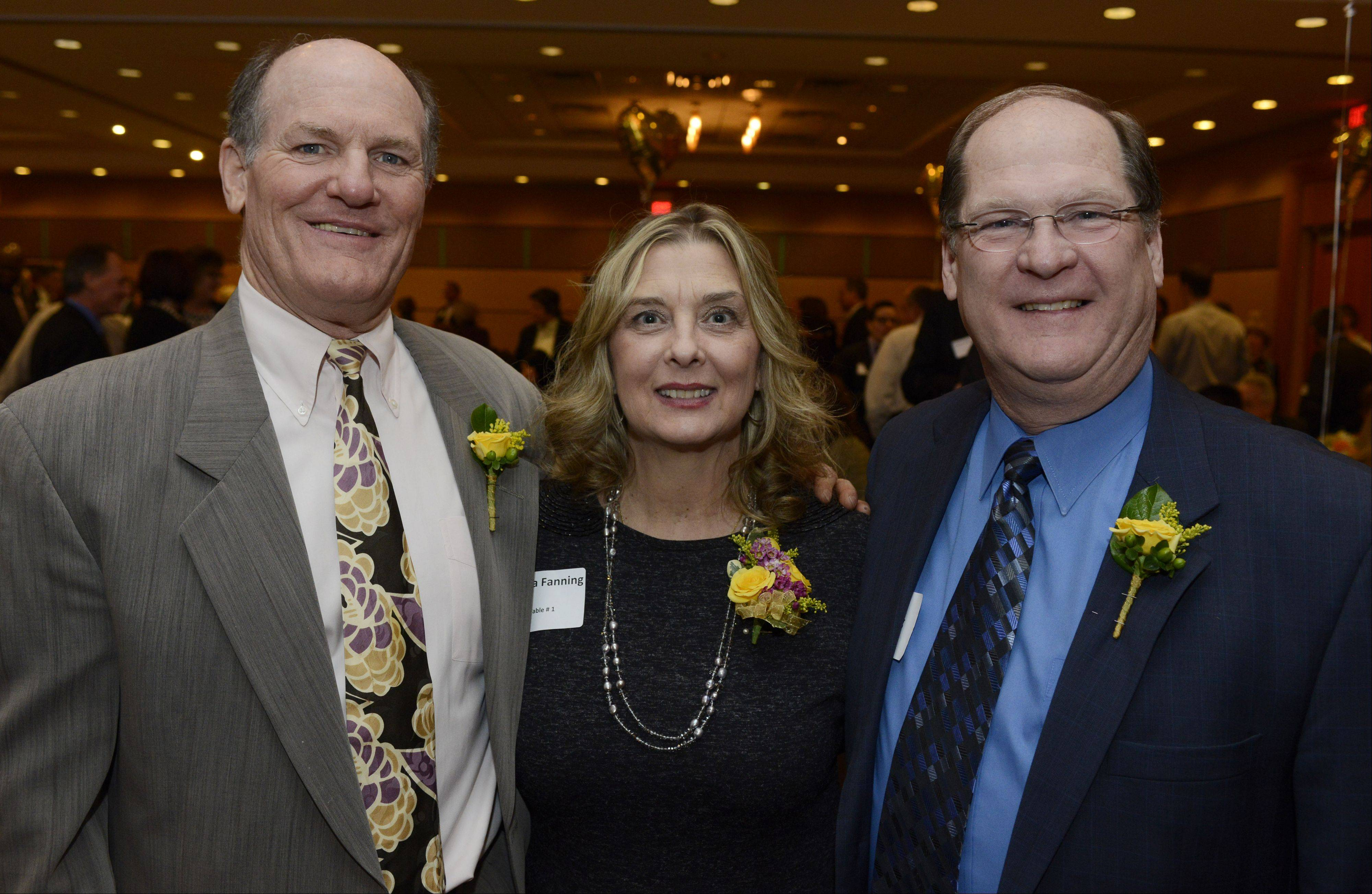 Left to right, Hearts of Gold Award winners Sam Moser, Donna Fanning and her husband, Patrick, during Arlington Heights� 15th annual Hearts of Gold dinner Saturday night. Moser won the Community Spirit Award, while the Fannings won the Heroic Award.