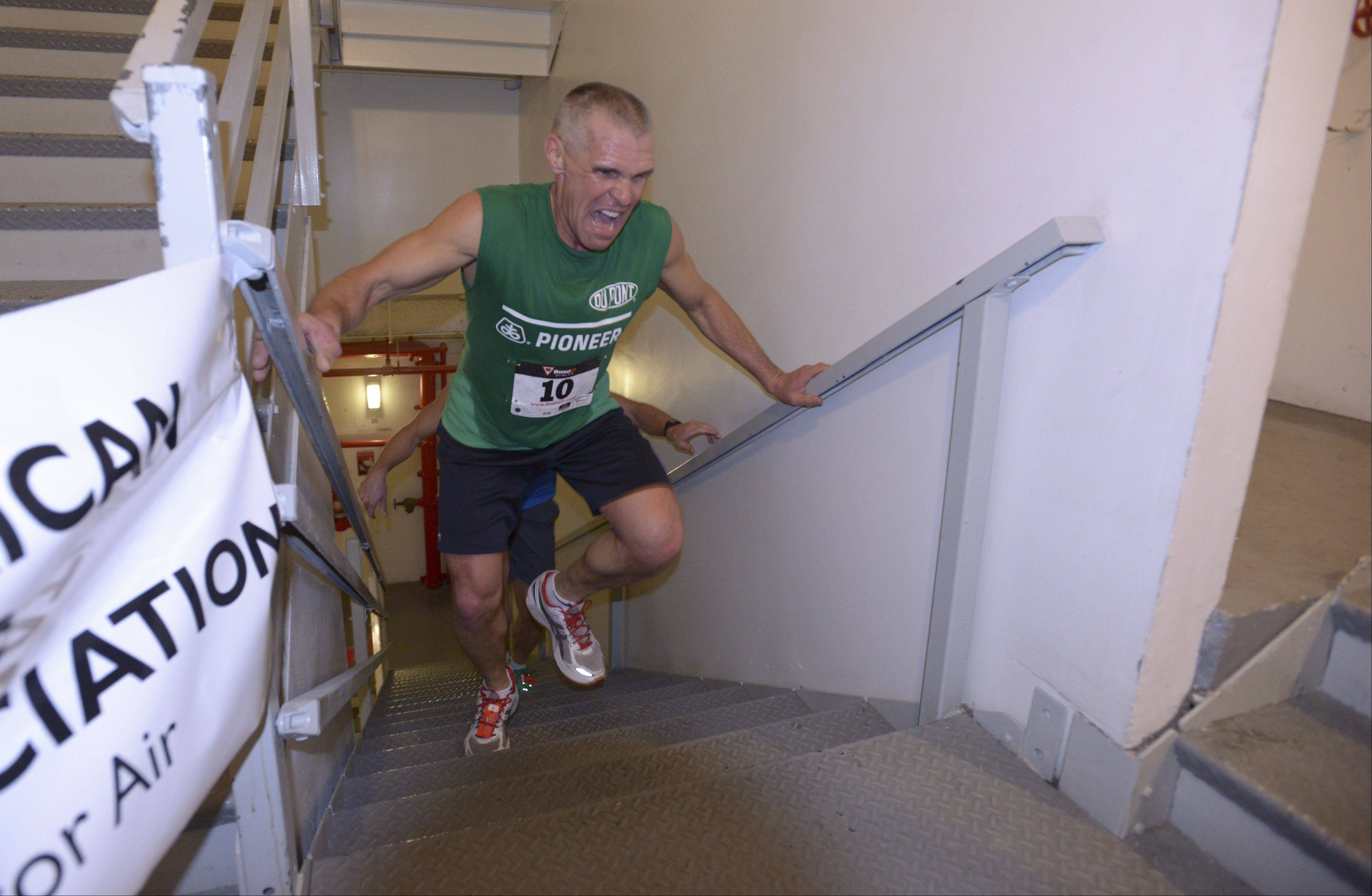 Dave Kestel of Manhattan, Ill. reaches the top of the Oakbrook Terrace Tower during one of his 10 back to back climbs Sunday morning as part of the Fight for Air Climb to benefit the American Lung Association. The tower is the tallest building in the suburbs.
