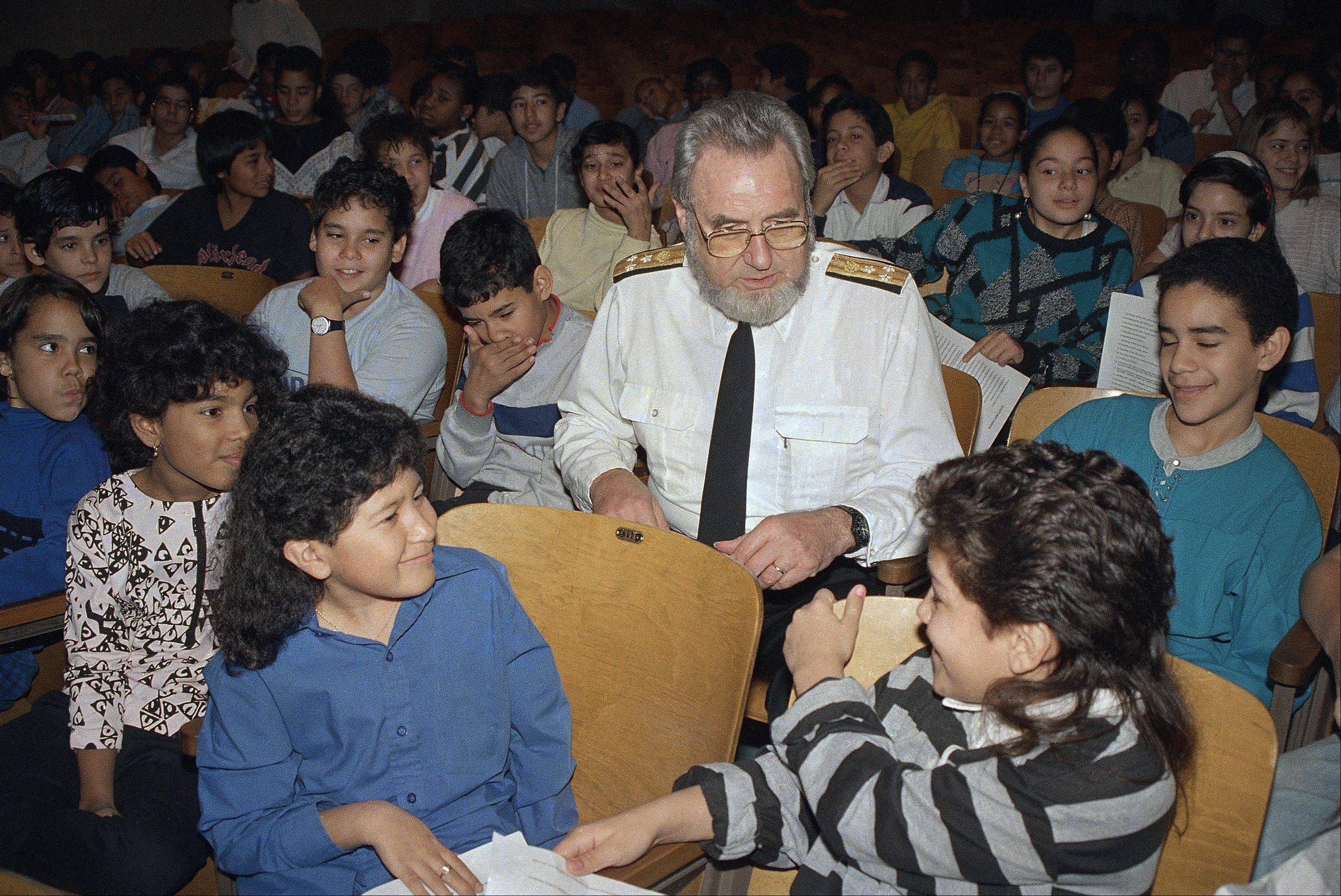 "U.S. Surgeon General C. Everett Koop sits with elementary school students at P.S. III in the Manhattan borough of New York to warn them of the dangers of smoking. In 1984, Koop called for a ""smoke-free society"" by the year 2000."