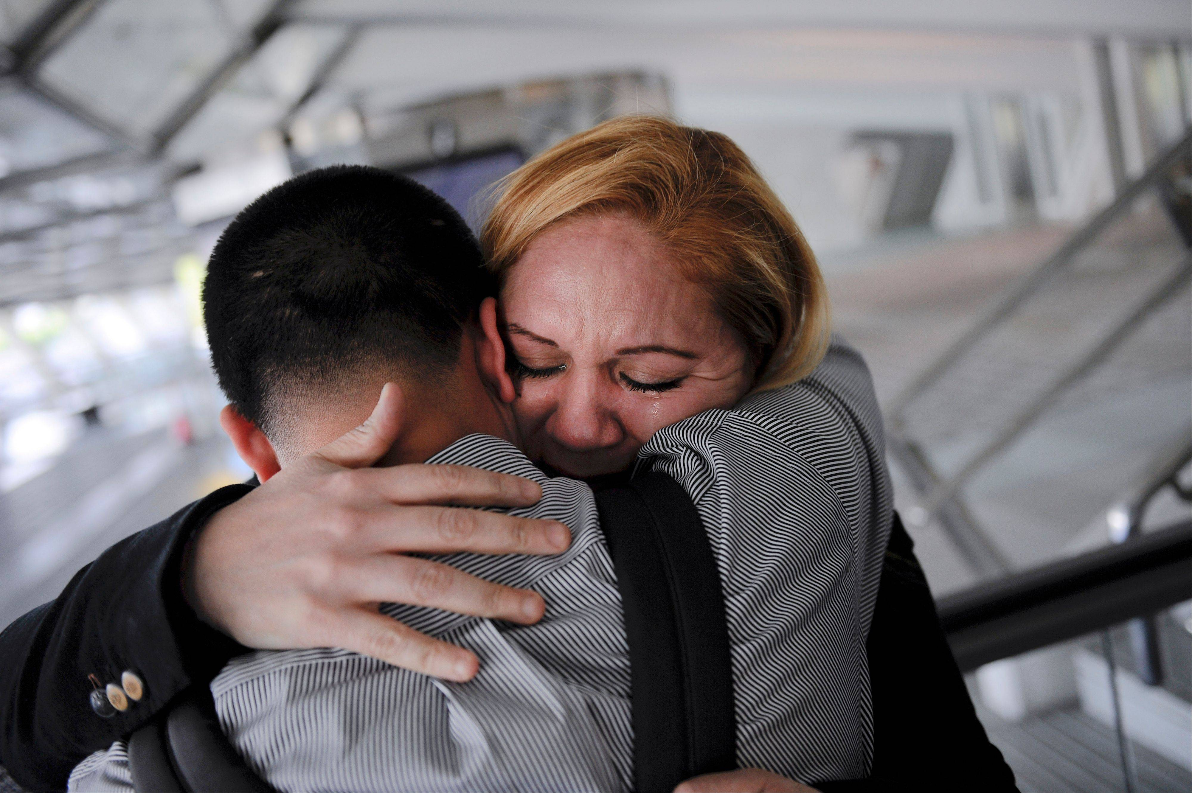 In this Wednesday, Dec. 25, 2013 photo, Melba Soza embraces her son Jose Antonio as he arrives at the airport in Bilbao, Spain from the United States for a five-day visit with his mother. For the past three years, Jose has been on a mission: To bring his mother back to the U.S. His work has taken him to Congress, gotten him meetings with the likes of Donald Trump and Mark Zuckerberg, landed him on television. Along the way, he has grown into a steady force in the national immigration debate, a young but powerful voice for his family and the many others hoping to one day reunite.