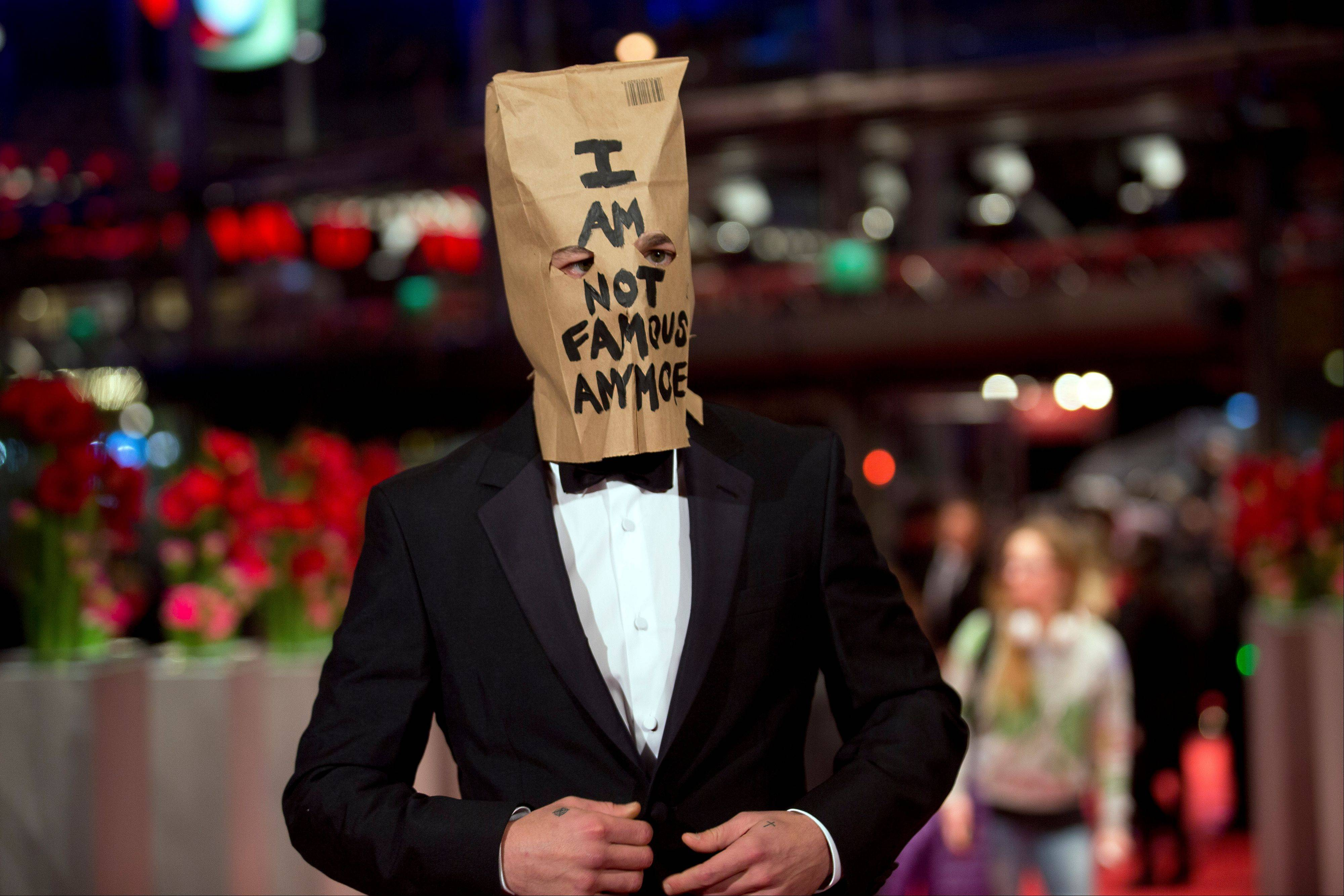 "Actor Shia LaBeouf poses for photographers, with a paper bag over his head that says ""I am not famous anymore,"" on the red carpet Sunday for the film ""Nymphomaniac"" at the International Film Festival Berlinale in Berlin."
