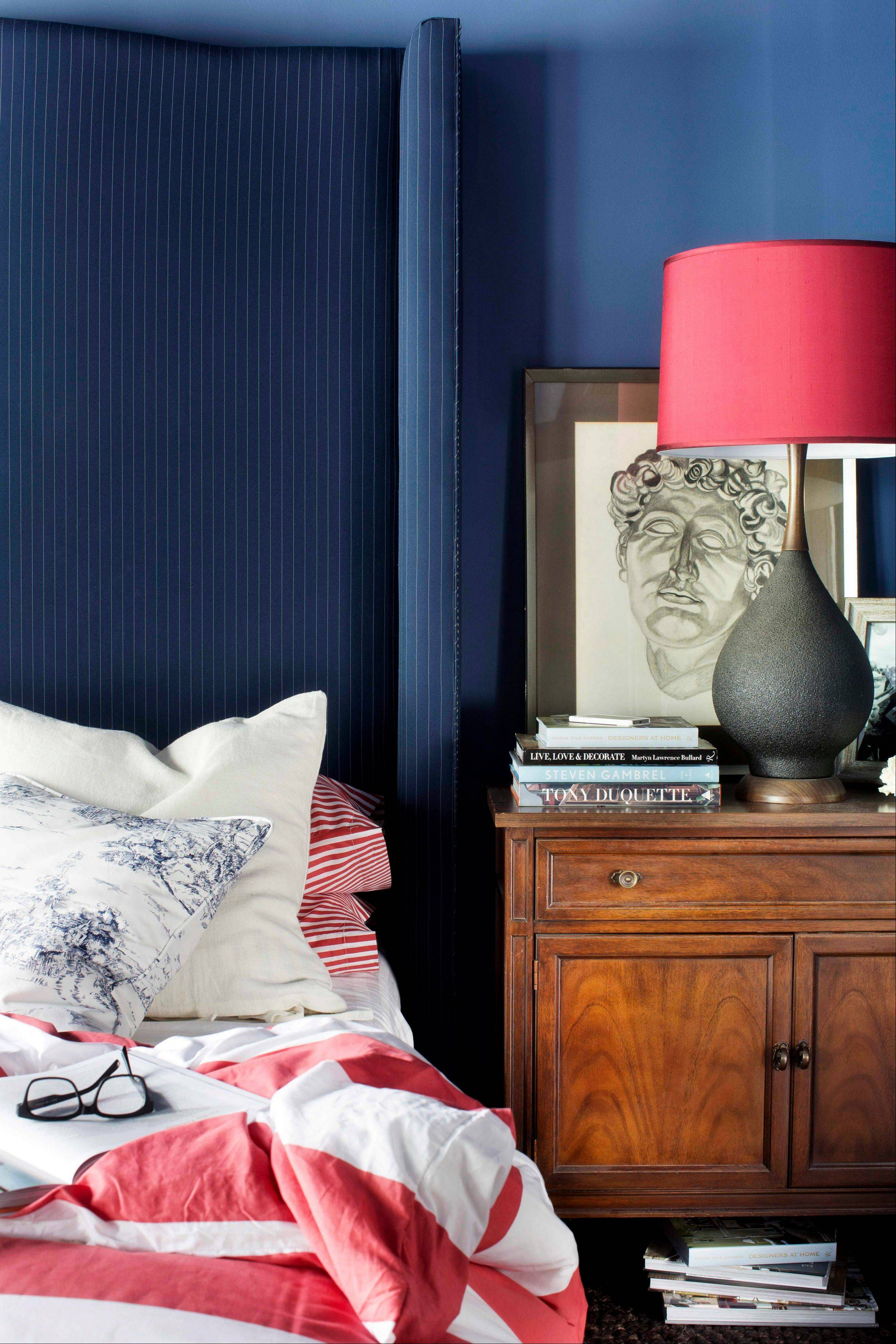 This bedroom designed by Brian Patrick Flynn and featured on HGTV.com demonstrates the designer's use of hefty chests and dressers next to beds rather than small night stands. Flynn suggests chests as an alternative due to their scale, especially in bedrooms with tall headboards.
