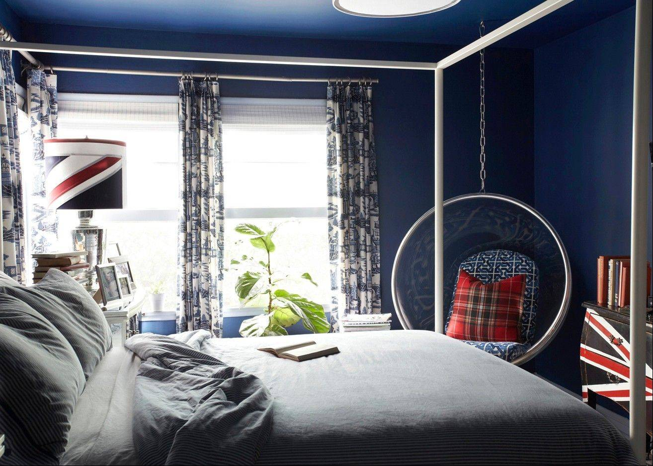 Designer Brian Patrick Flynn layered his windows with blackout shades from Texton and custom drapery panels lined with blackout liner in his own bedroom in Los Angeles. The layering helps with the noise control and the blackout liner helps him to sleep in on weekends.
