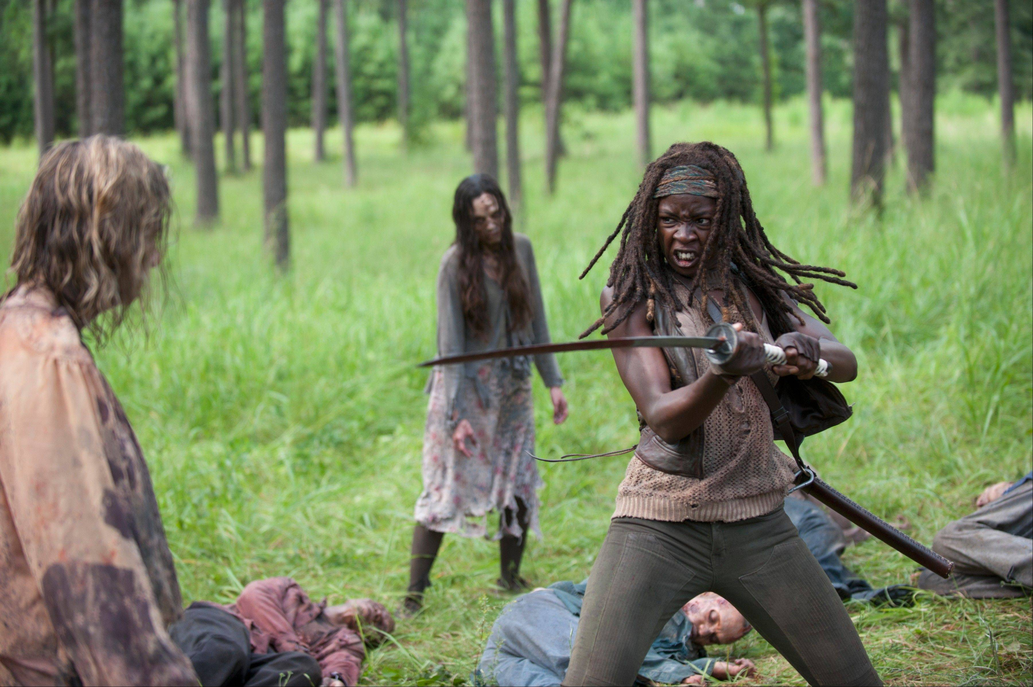 "Michonne (Danai Gurira) fights off walkers as the second half of season 4 of ""The Walking Dead"" returns Sunday, Feb. 9."