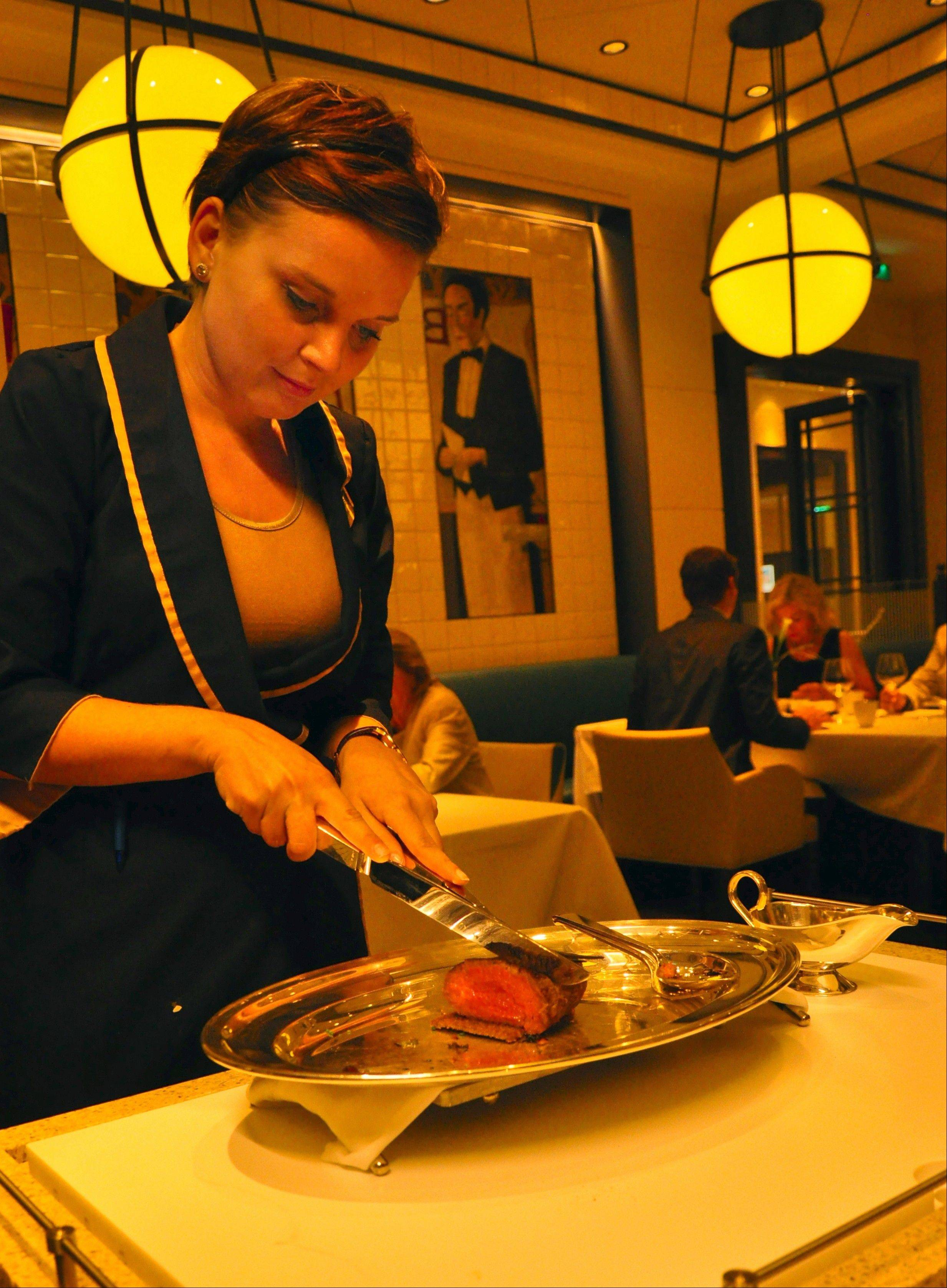 Chateaubriand is carved tableside in the Europa 2's French restaurant, Tarragon.
