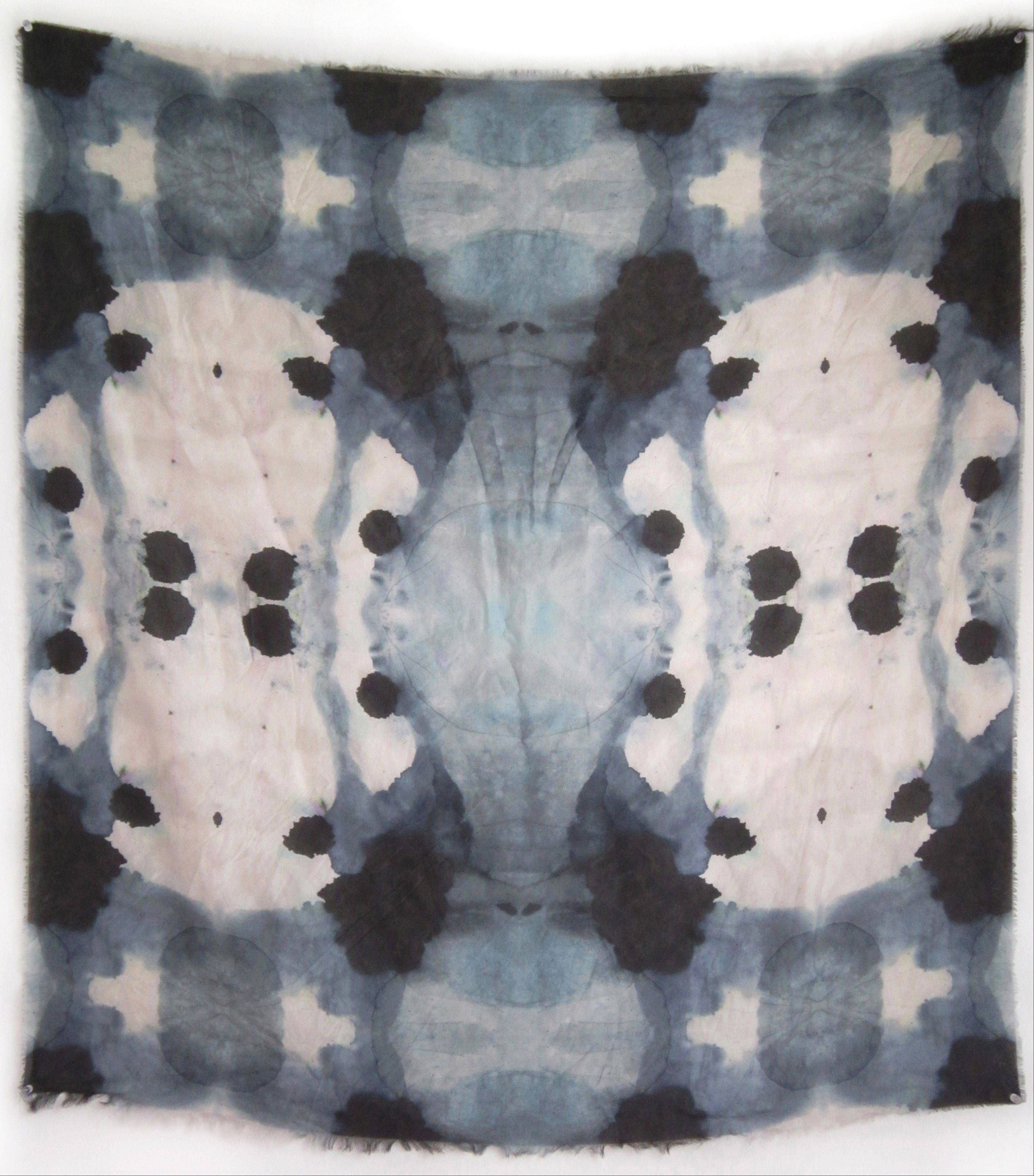 A shibori scarf produced by Eskayel, a design firm based in New York. The home-design purveyor is creating the look of shibori patterns using ink, water and watercolors, followed by digital printing techniques.
