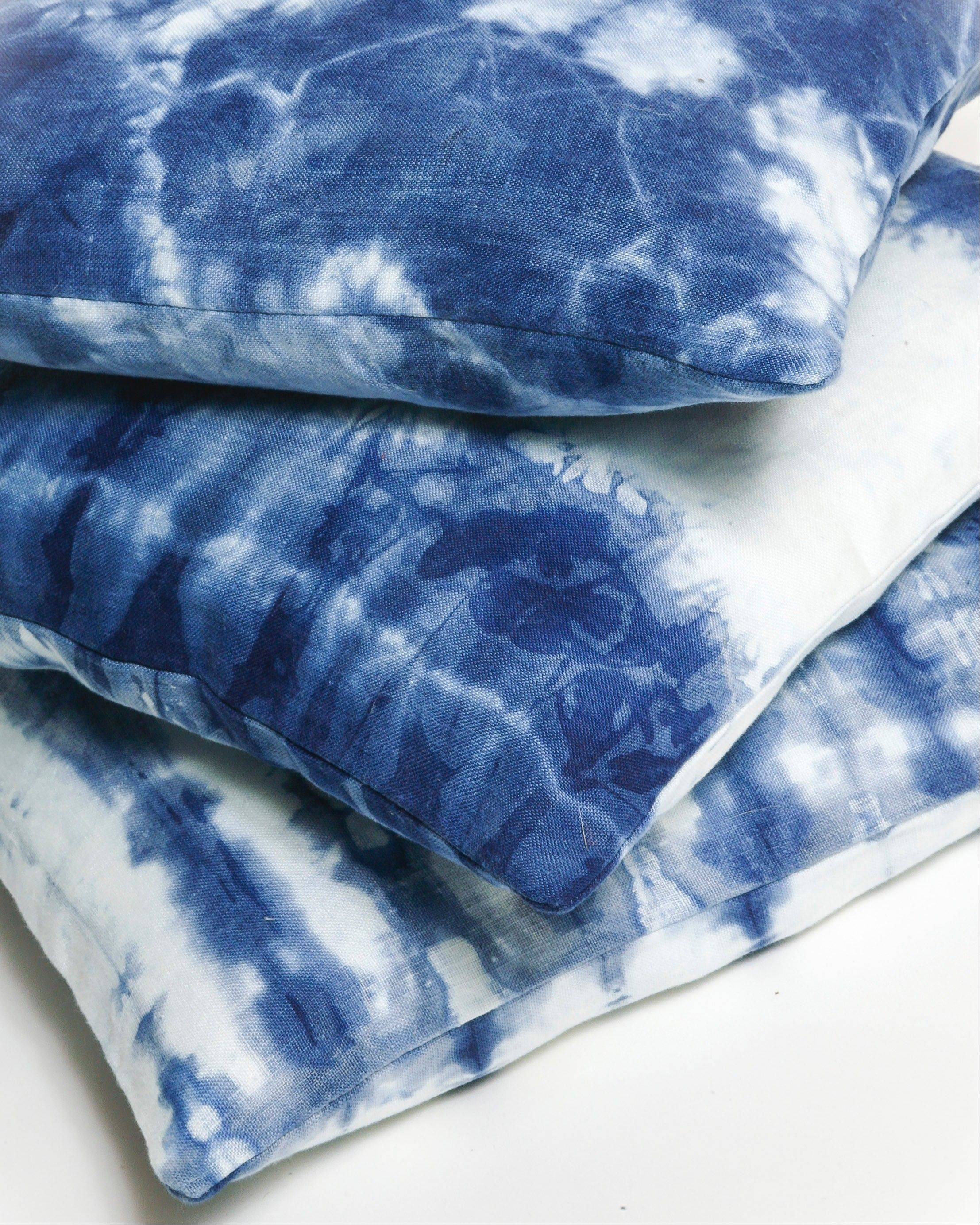 OriShibori pillows by Oriana DiNella, who recently launched her own Web-based shibori line, OriShibori.com. The line includes linen tableware, pillows and throws, and large leather wall hangings. They are all made to order and hand-dyed in organic indigo.